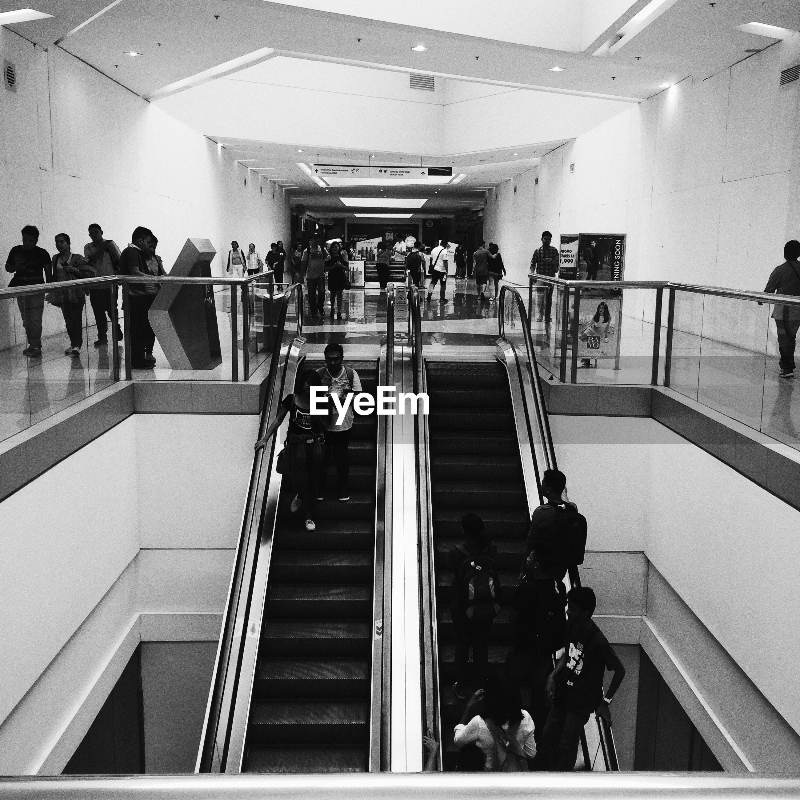 indoors, travel, railing, steps and staircases, large group of people, adults only, men, staircase, only men, illuminated, people, adult, architecture, day