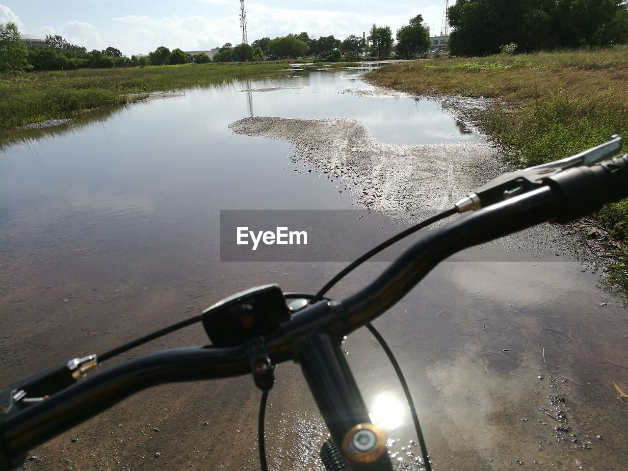 water, transportation, bicycle, mode of transport, river, metal, day, no people, land vehicle, outdoors, nature, close-up, sky