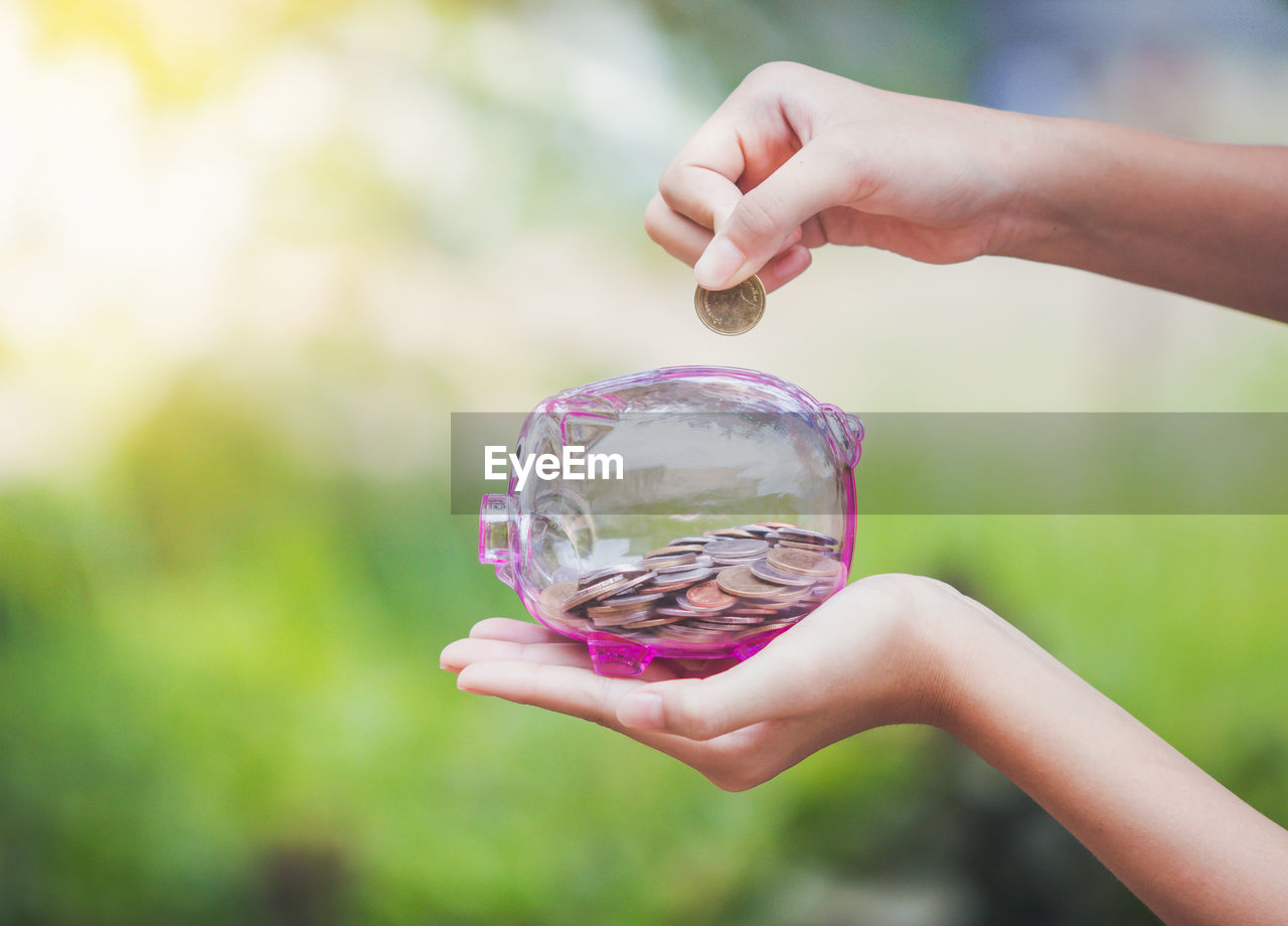 human hand, hand, holding, human body part, one person, focus on foreground, real people, day, close-up, lifestyles, leisure activity, outdoors, childhood, women, nature, child, sphere, body part, unrecognizable person, finger