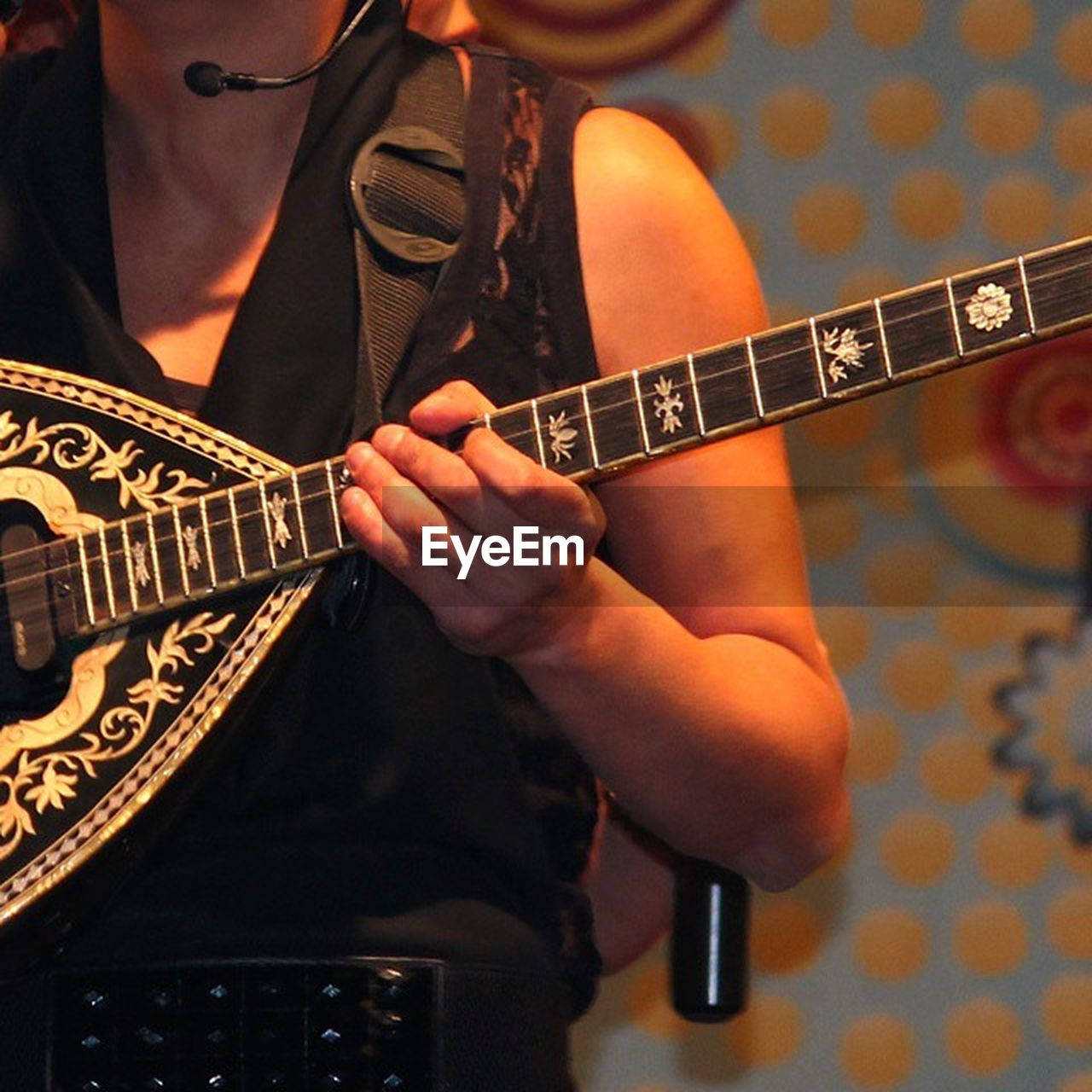 musical instrument, music, midsection, guitar, playing, real people, indoors, one person, skill, plucking an instrument, holding, arts culture and entertainment, lifestyles, leisure activity, occupation, electric guitar, musician, standing, musical instrument string, close-up, fretboard, human hand, day, adult, people, adults only