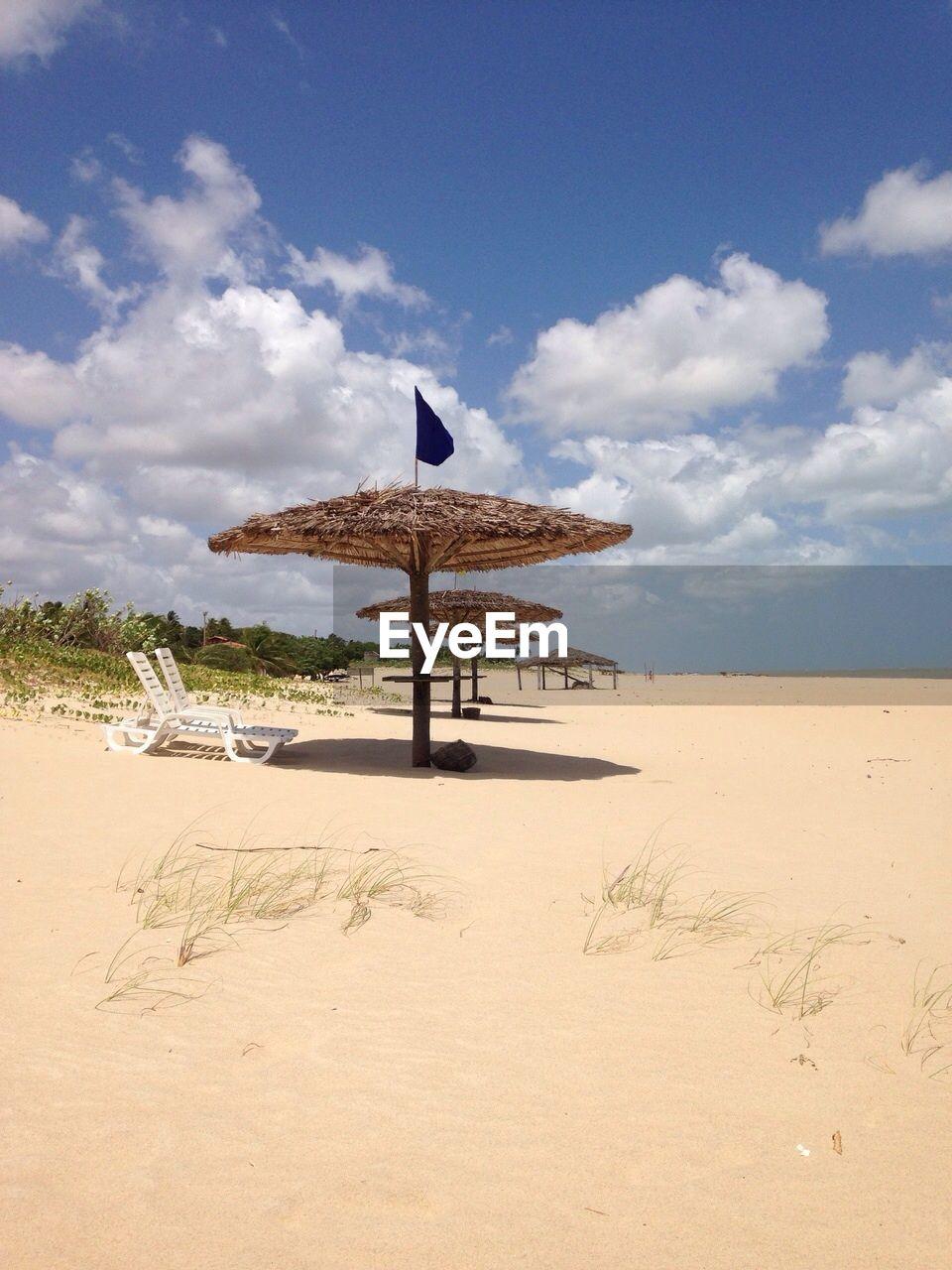 Sunshades on sandy beach