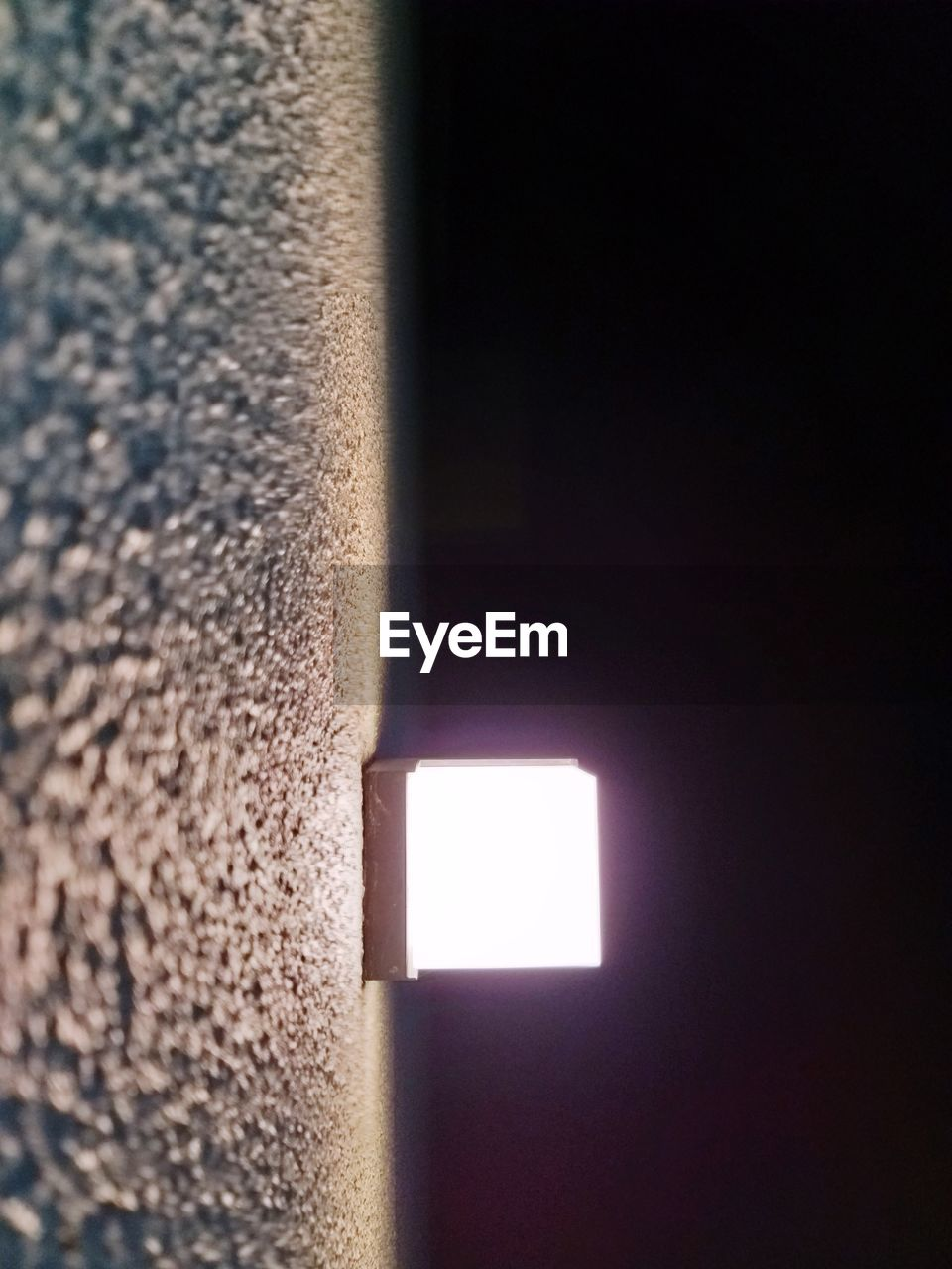 close-up, no people, wall - building feature, indoors, copy space, sunlight, window, architecture, built structure, day, wall, nature, lighting equipment, textured, illuminated, light - natural phenomenon, light, low angle view, geometric shape