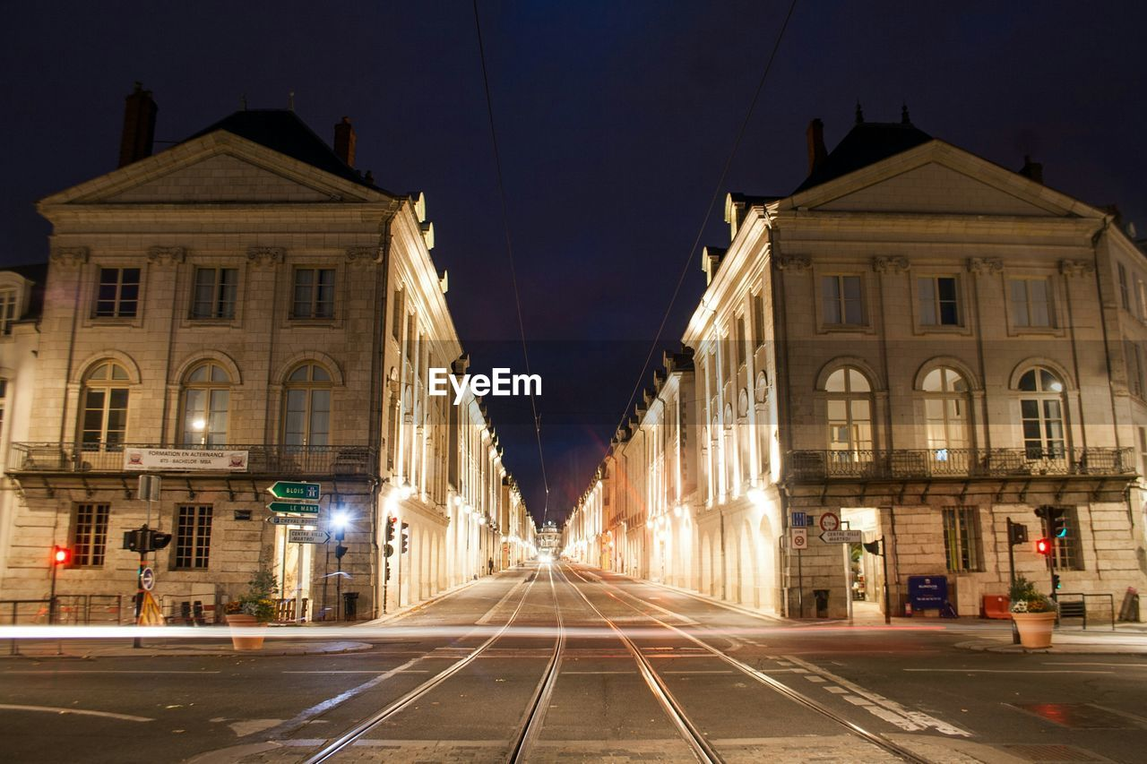 Light Trails On Street By Buildings In City At Night