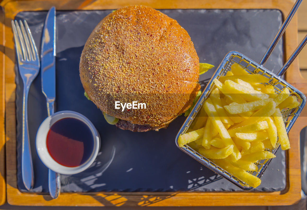 food, food and drink, freshness, still life, ready-to-eat, indoors, healthy eating, close-up, table, bread, no people, yellow, wellbeing, burger, sandwich, snack, high angle view, fast food, fruit, tray, temptation