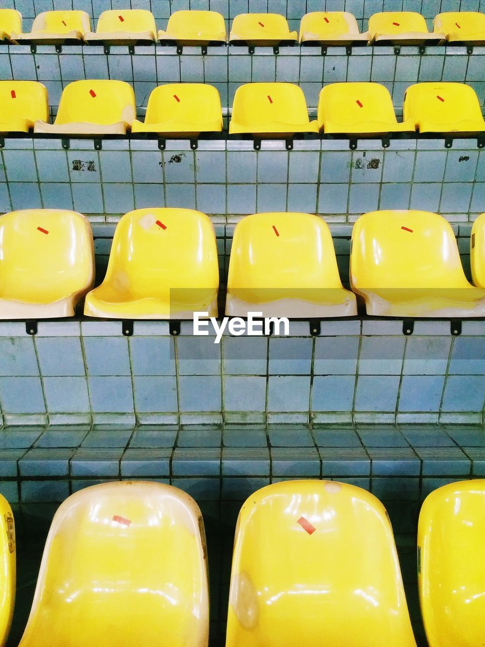 Empty Yellow Bleachers In Stadium