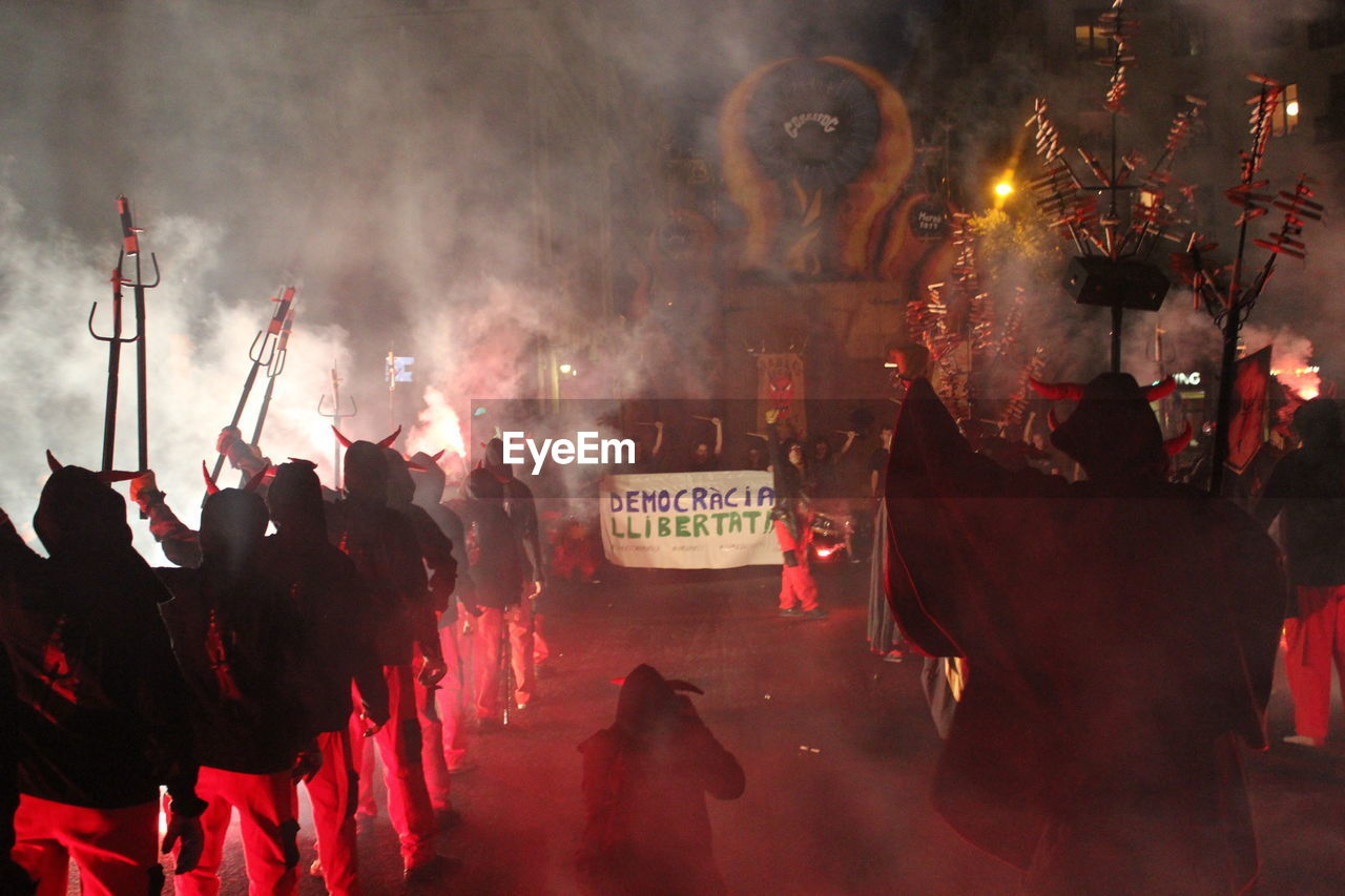 large group of people, real people, smoke - physical structure, night, men, celebration, women, outdoors, crowd, ceremony, protestor, riot, adult, people