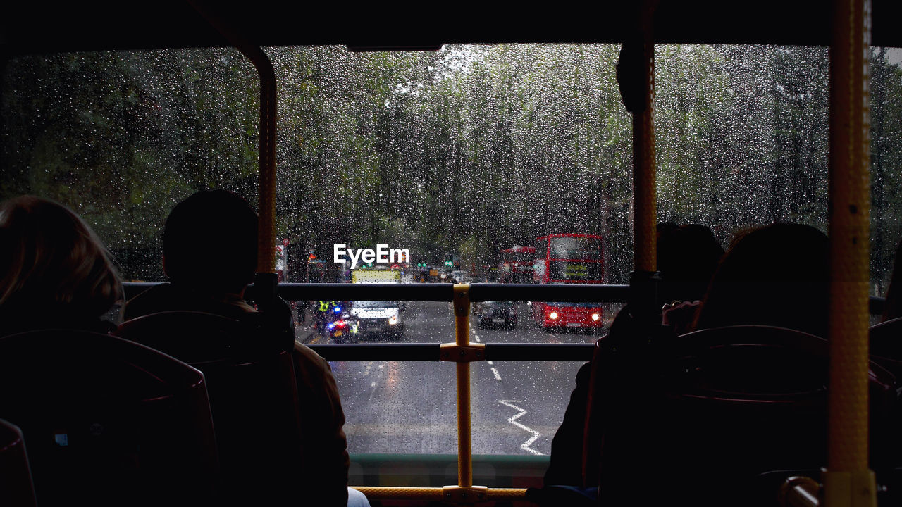 People Traveling In Bus On Rainy Day