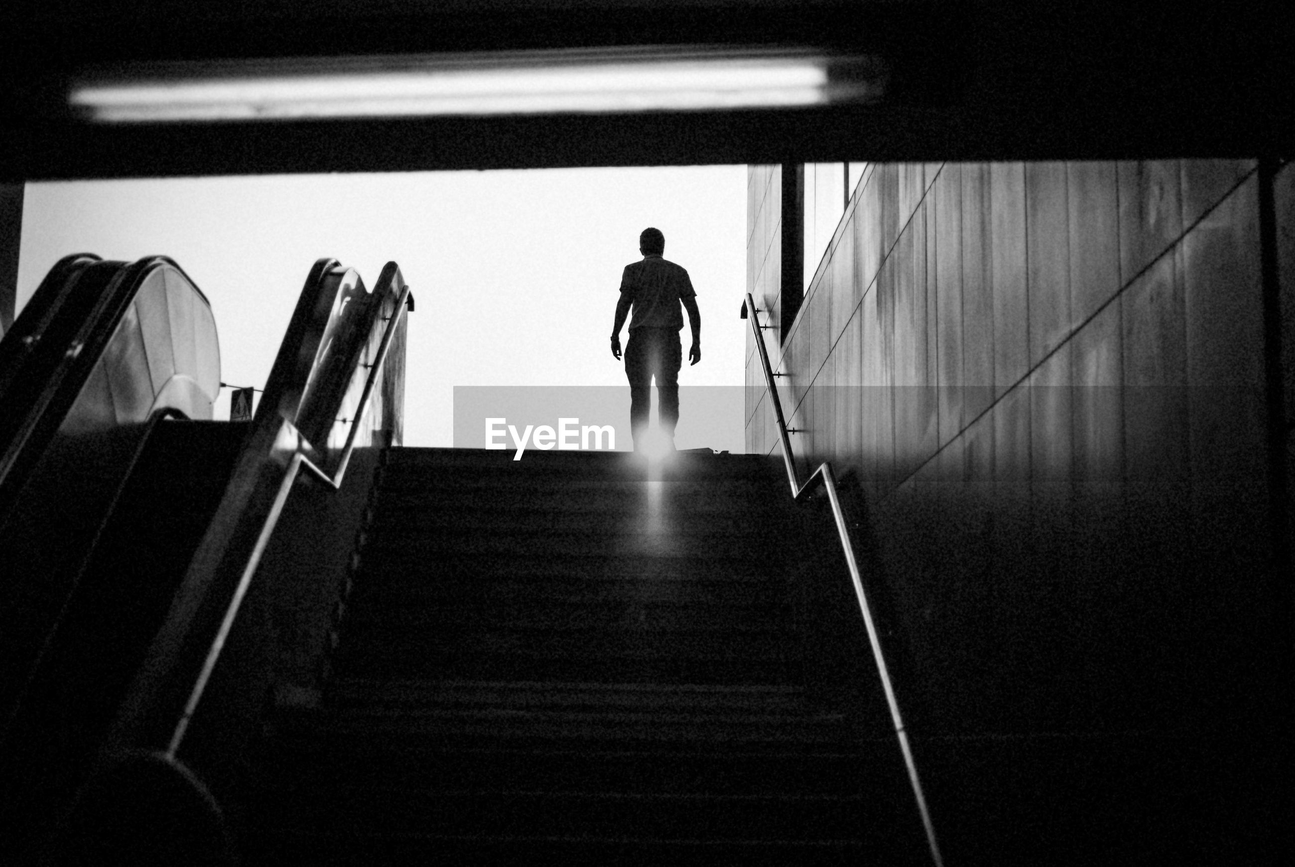 Low angle view of man walking on steps
