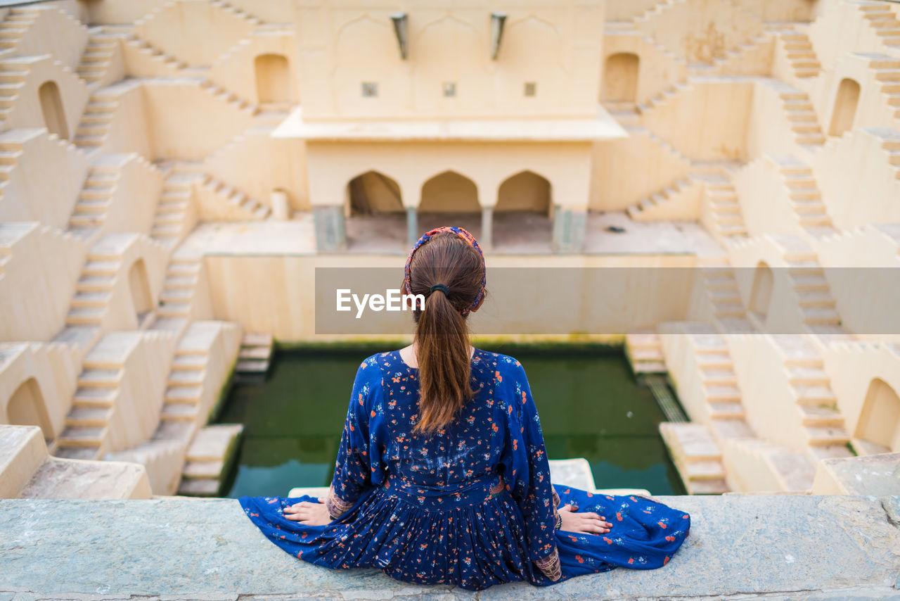 Rear View Of Woman Sitting At Chand Baori