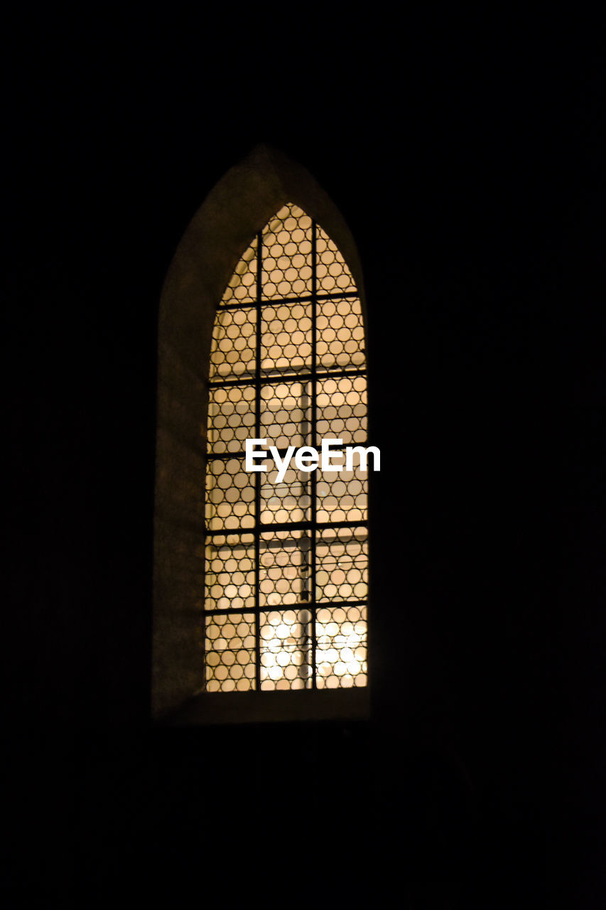 window, copy space, dark, indoors, arch, no people, architecture, built structure, day, religion, domestic room, sunlight, nature, belief, darkroom, spirituality, glass - material, place of worship, building, black background