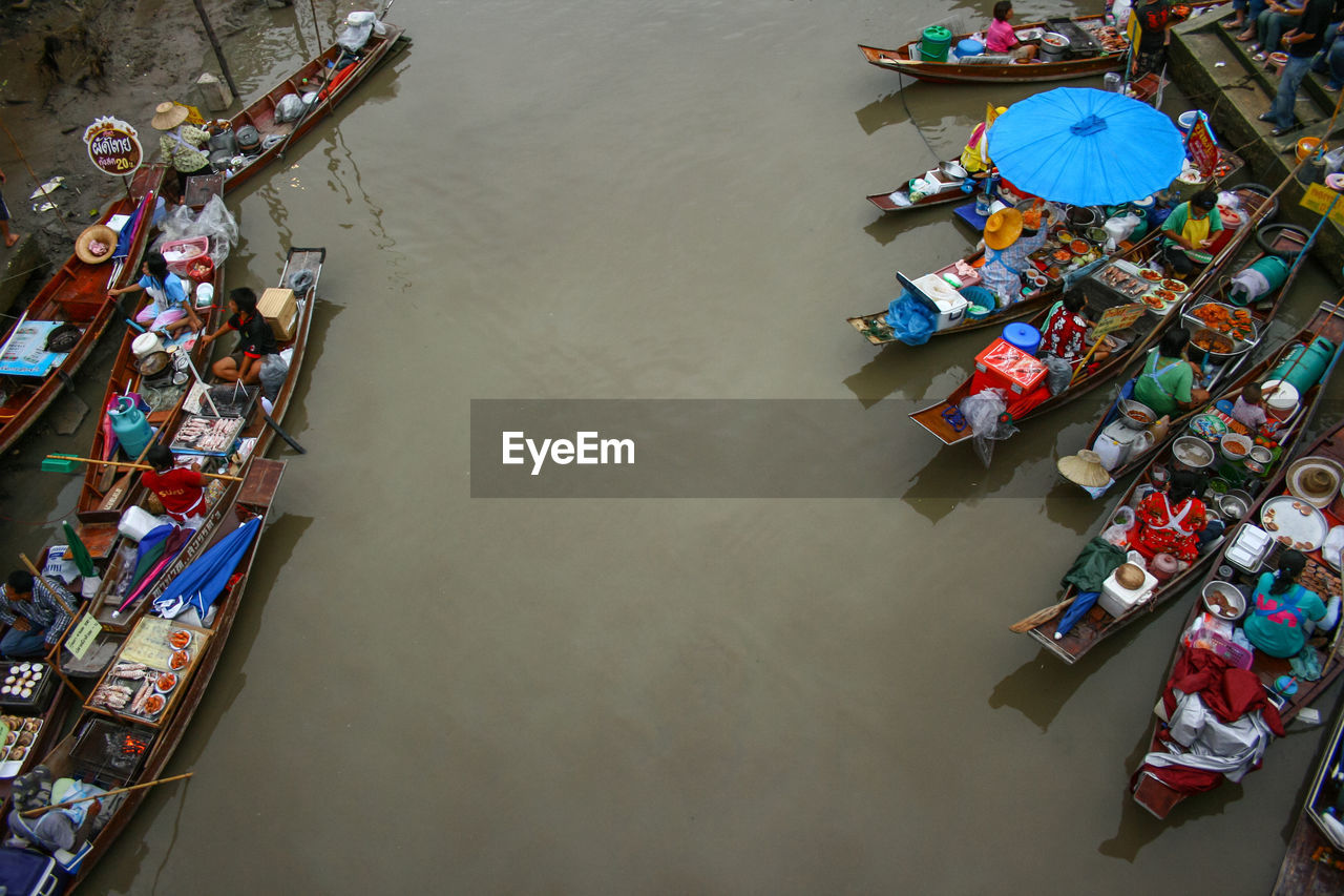 HIGH ANGLE VIEW OF PEOPLE IN BOAT ON RIVER