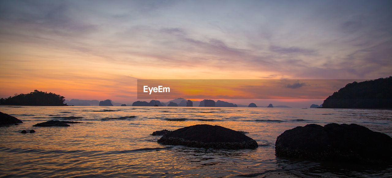sky, water, sunset, scenics - nature, sea, beauty in nature, cloud - sky, tranquility, rock, tranquil scene, rock - object, solid, no people, nature, idyllic, land, beach, orange color, silhouette, outdoors, stack rock