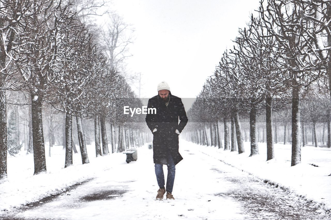 Portrait Of Man In Snow Covered Park