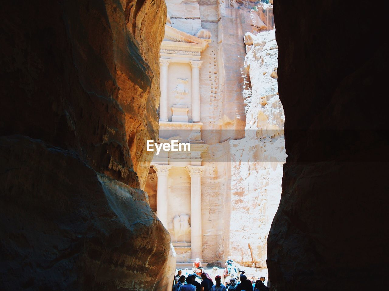 People amidst rock formations at petra