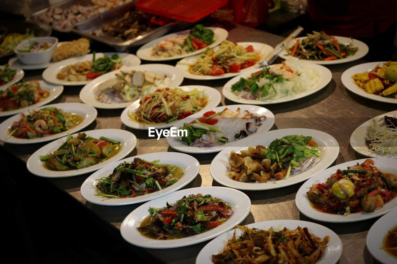 food and drink, food, plate, ready-to-eat, freshness, table, indoors, healthy eating, wellbeing, serving size, high angle view, still life, choice, no people, variation, bowl, meal, abundance, vegetable, close-up, chinese food, garnish, dinner