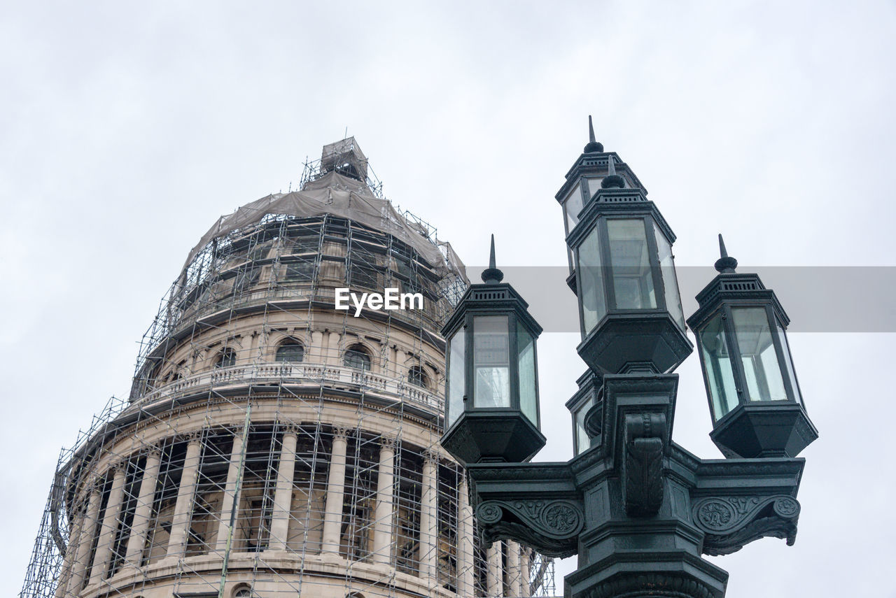 Low Angle View Of Street Light By El Capitolio Under Construction Against Sky
