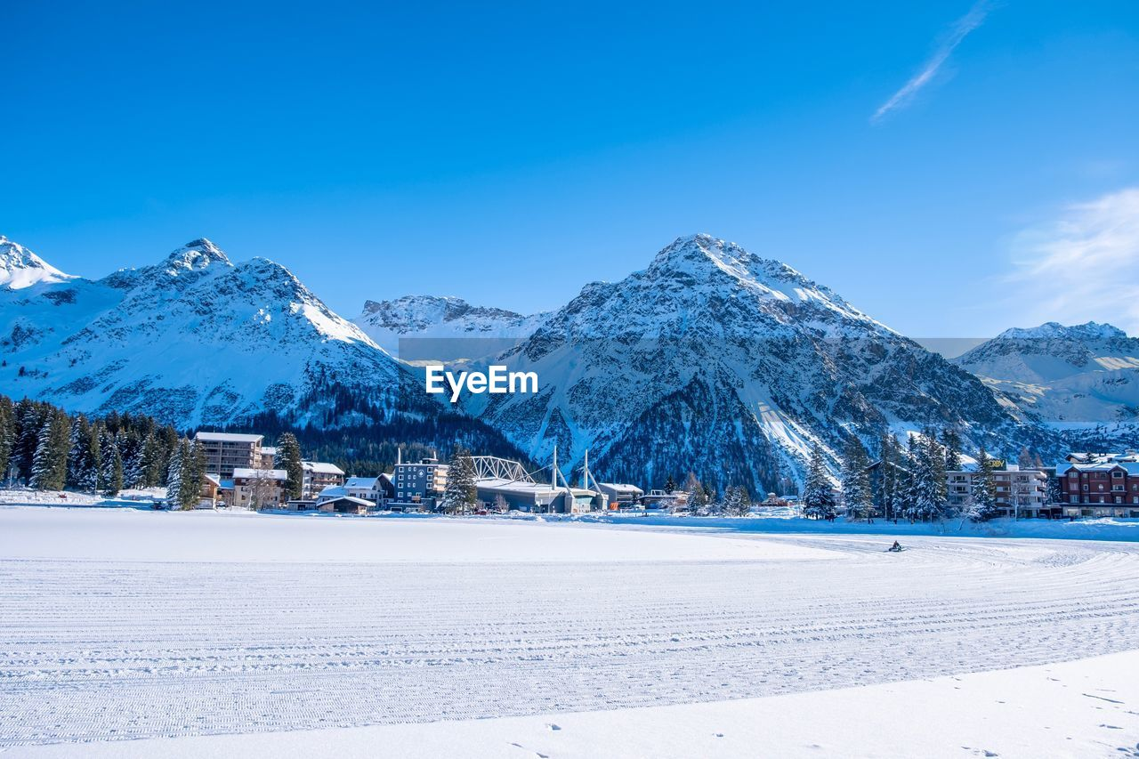 cold temperature, snow, winter, mountain, sky, scenics - nature, beauty in nature, snowcapped mountain, tranquil scene, tranquility, white color, environment, mountain range, landscape, blue, nature, no people, covering, non-urban scene, mountain peak
