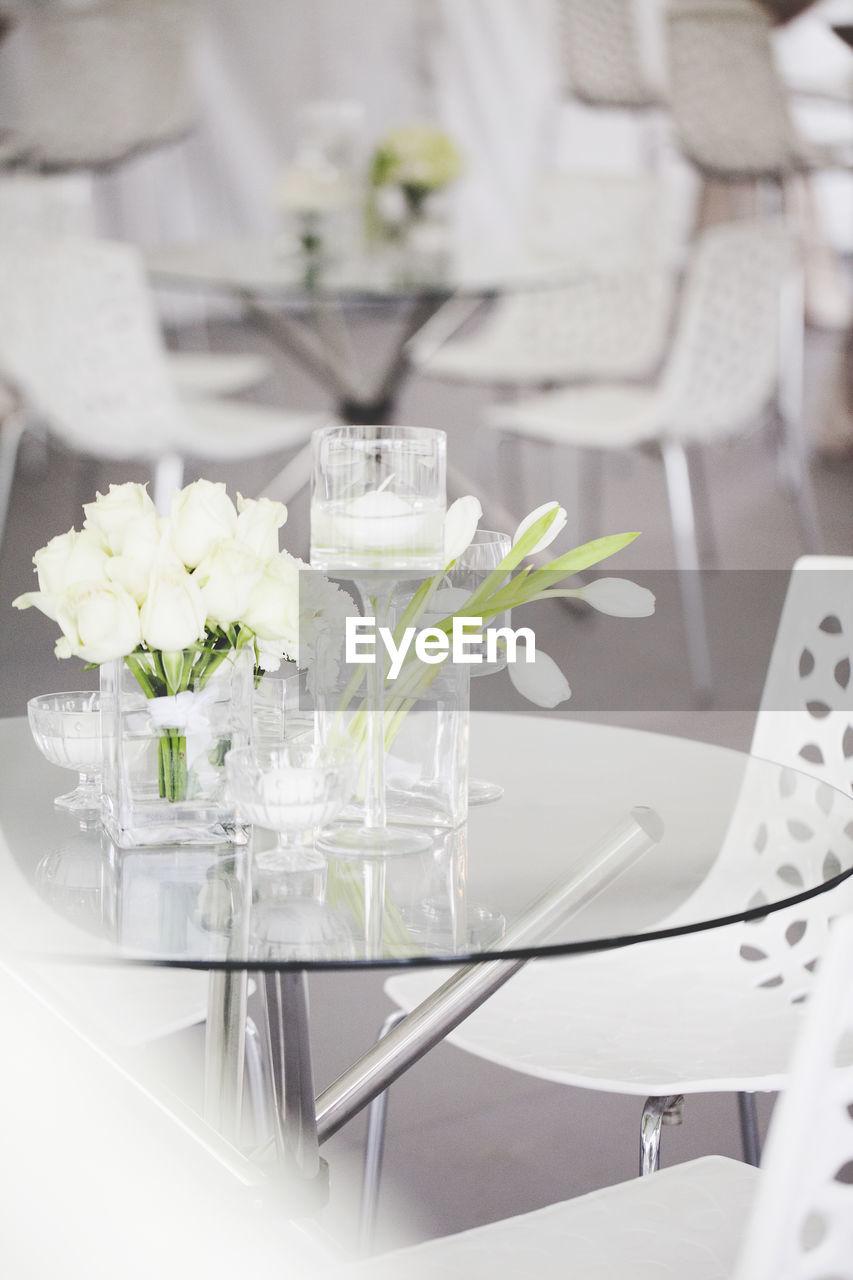 Flower Vase On Grass Table In Restaurant