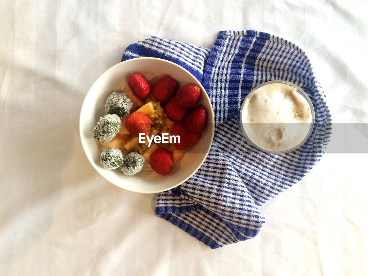 Directly Above Shot Of Fruits In Bowl With Coffee On Table