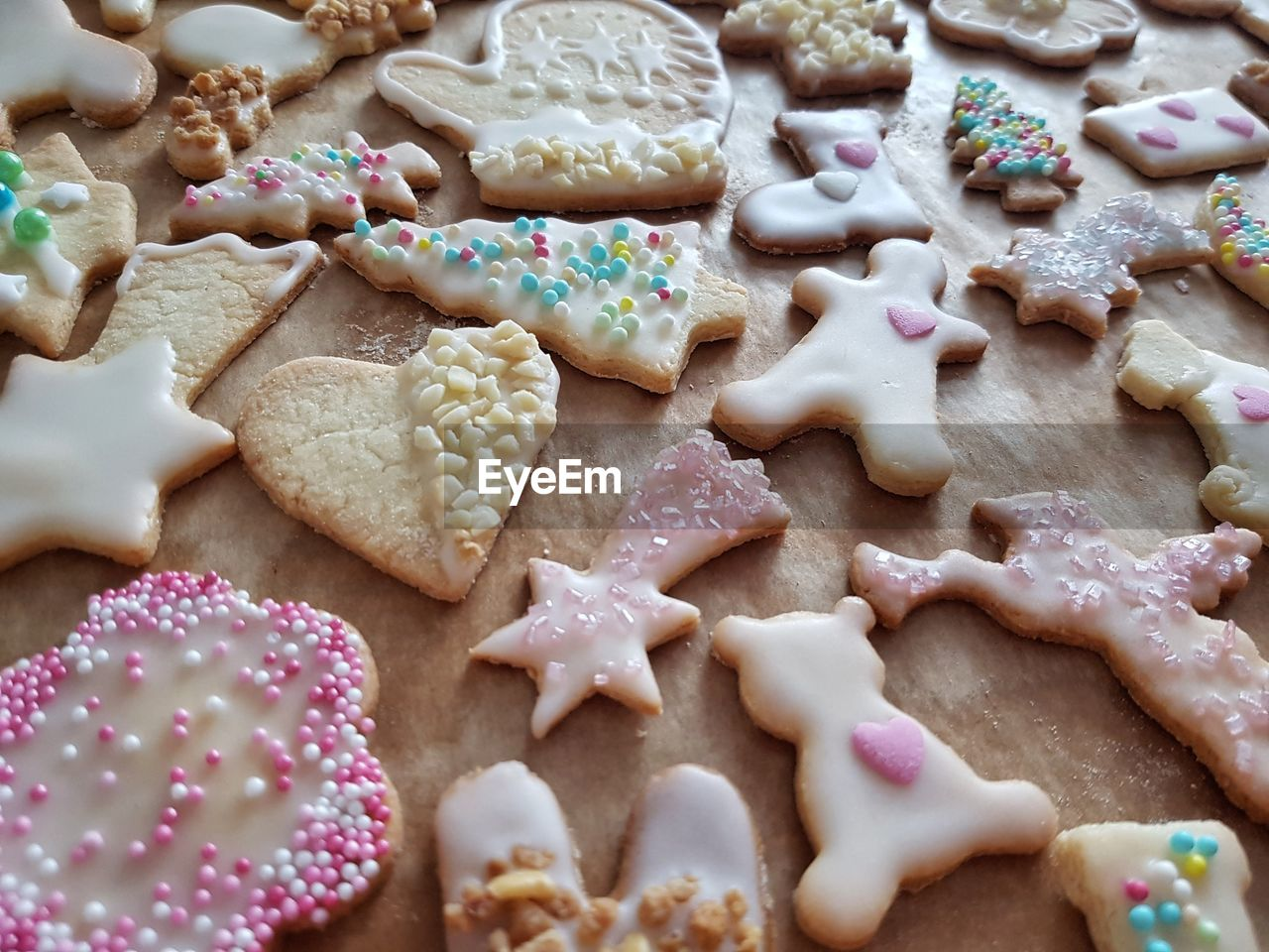 food and drink, sweet food, still life, food, indoors, temptation, indulgence, no people, cookie, shape, freshness, dessert, table, high angle view, christmas, sprinkles, ready-to-eat, close-up, day