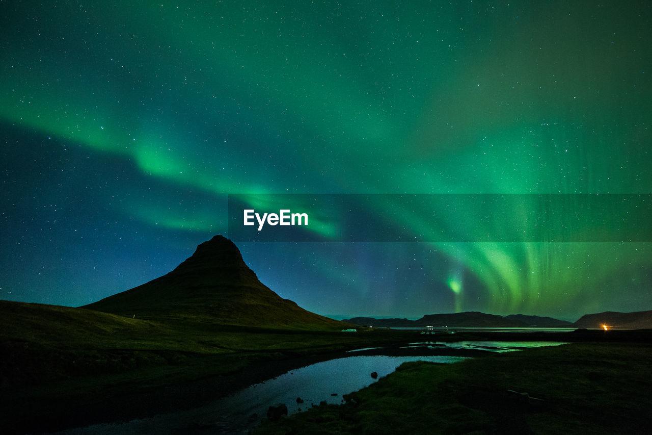 Scenic View Of Aurora Polaris Over Kirkjufell Mountain