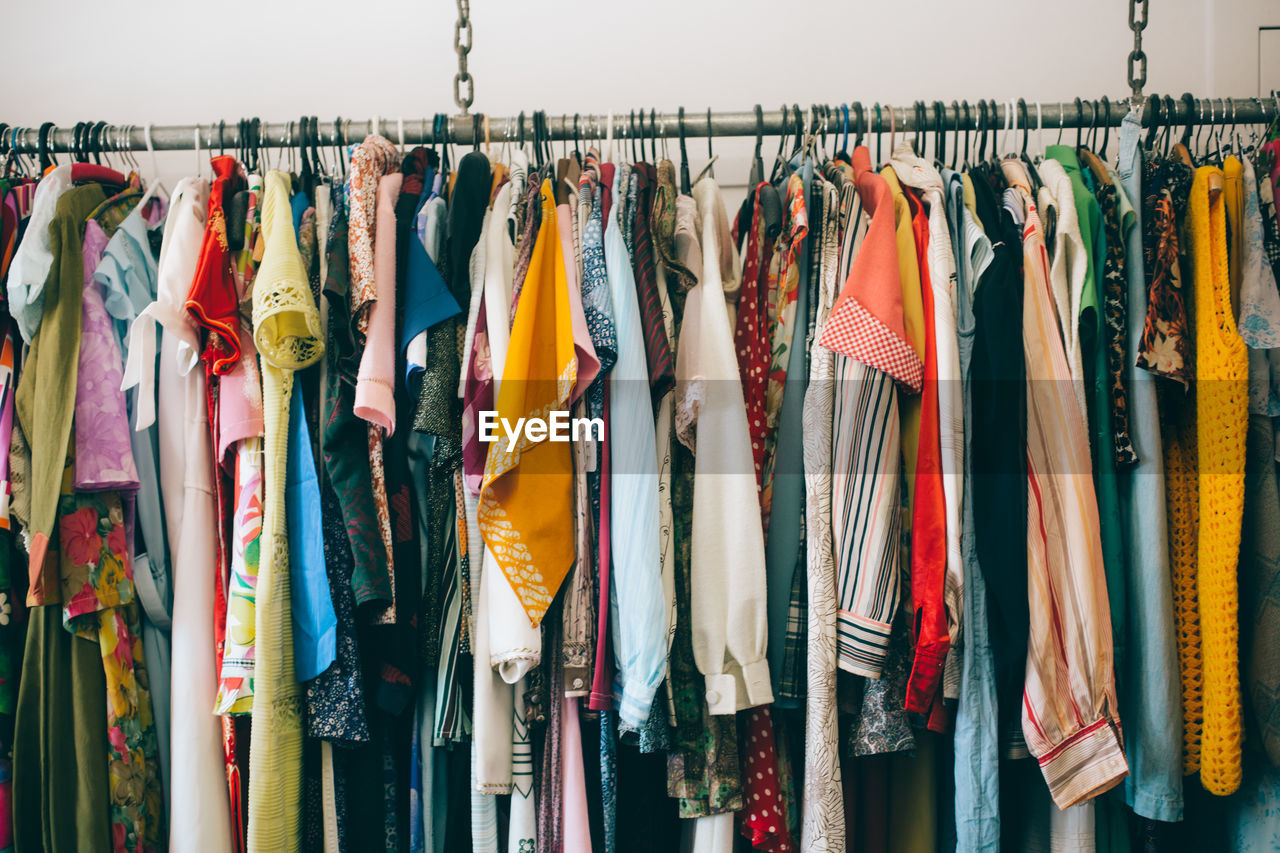 View of clothes hanging at market stall