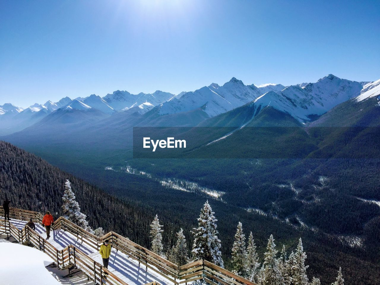 mountain, mountain range, scenics - nature, beauty in nature, sky, winter, snow, cold temperature, nature, tranquil scene, tree, tranquility, environment, non-urban scene, day, sunlight, landscape, plant, idyllic, snowcapped mountain, outdoors, ski resort