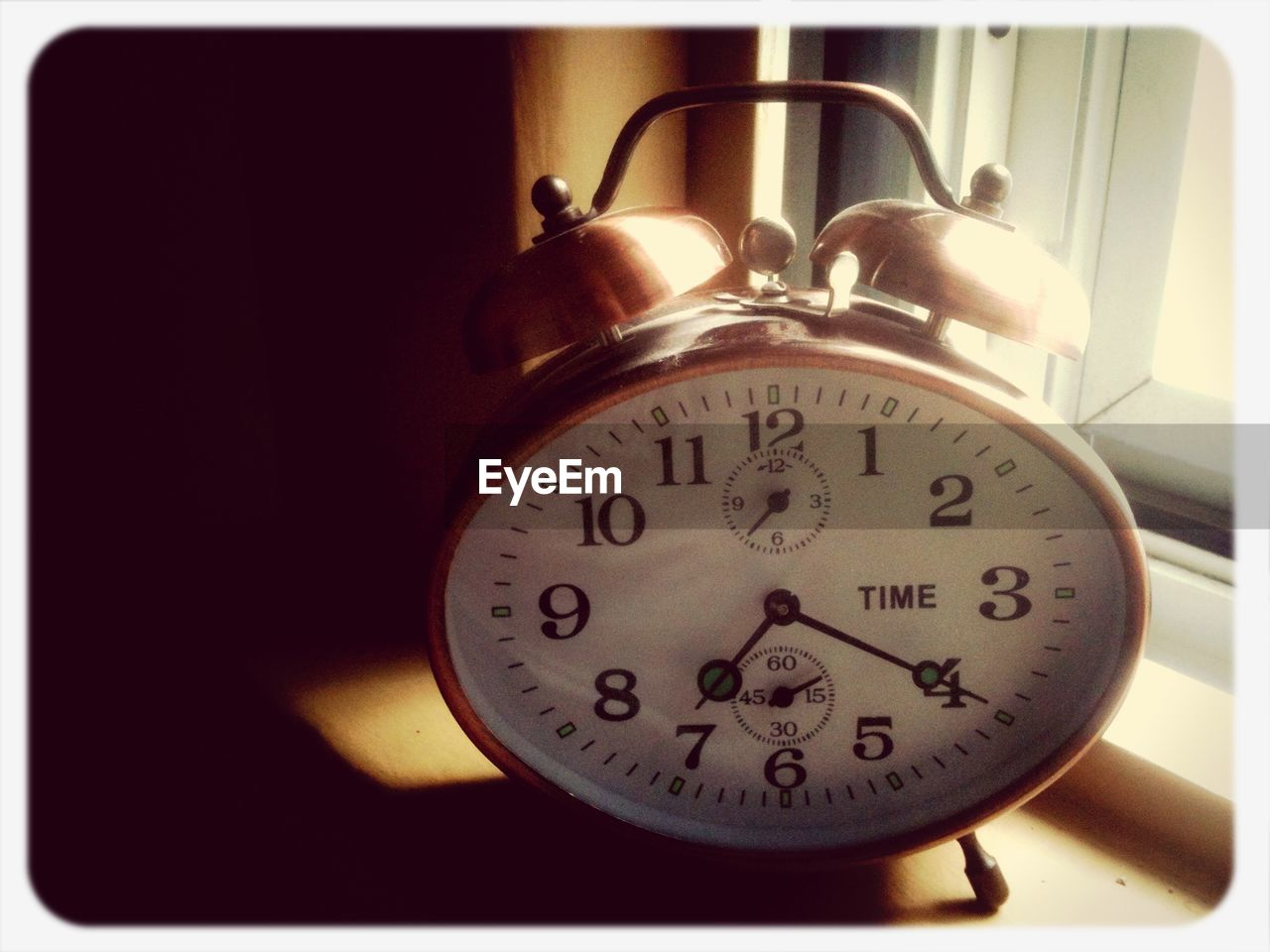 Alarm clock on table at home
