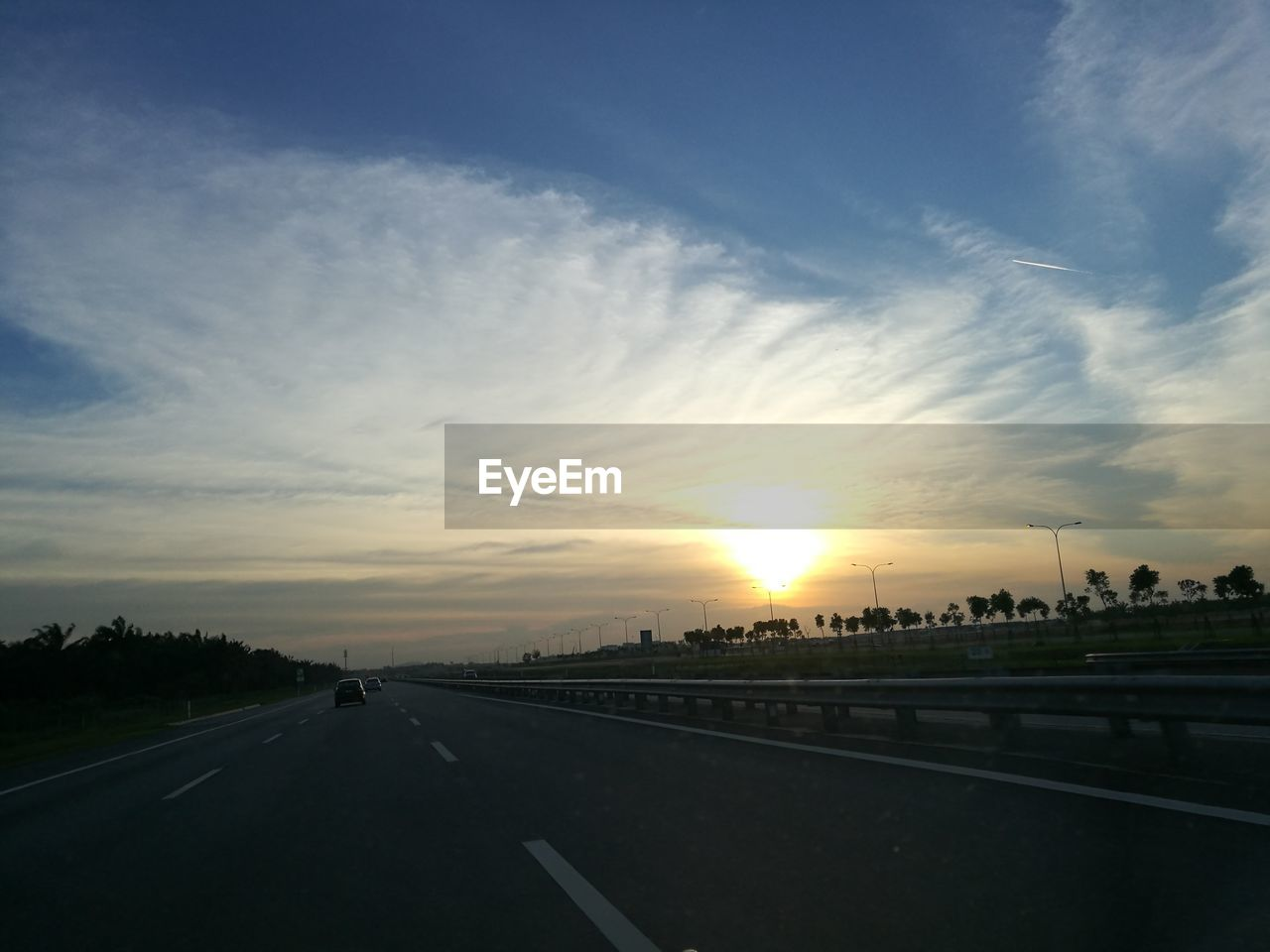 sunset, road, transportation, car, sky, sun, the way forward, travel, cloud - sky, no people, nature, outdoors, scenics, beauty in nature, architecture, city, day