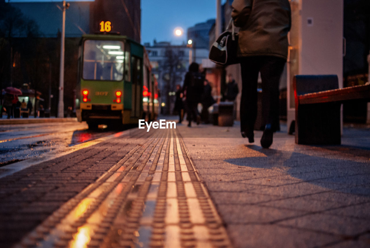 Tramway Moving On Street At Dusk During Foggy Weather