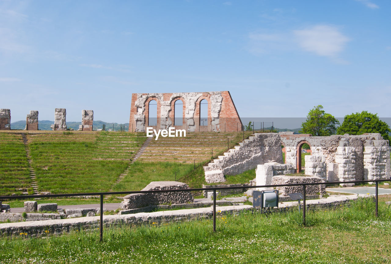 history, architecture, the past, sky, built structure, ancient, grass, nature, day, plant, travel destinations, old ruin, travel, tourism, no people, old, ancient civilization, outdoors, archaeology, memorial, ruined