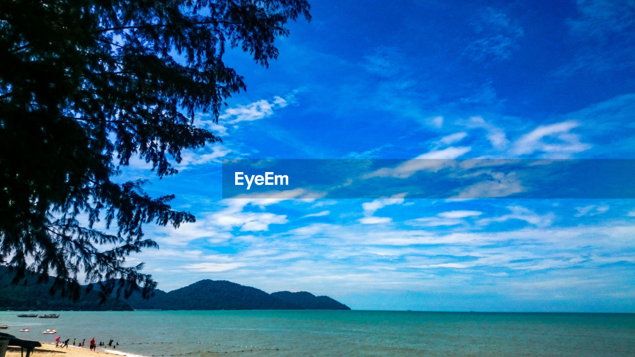 sky, nature, tranquility, blue, scenics, sea, beauty in nature, tranquil scene, water, outdoors, tree, cloud - sky, day, horizon over water, no people, mountain