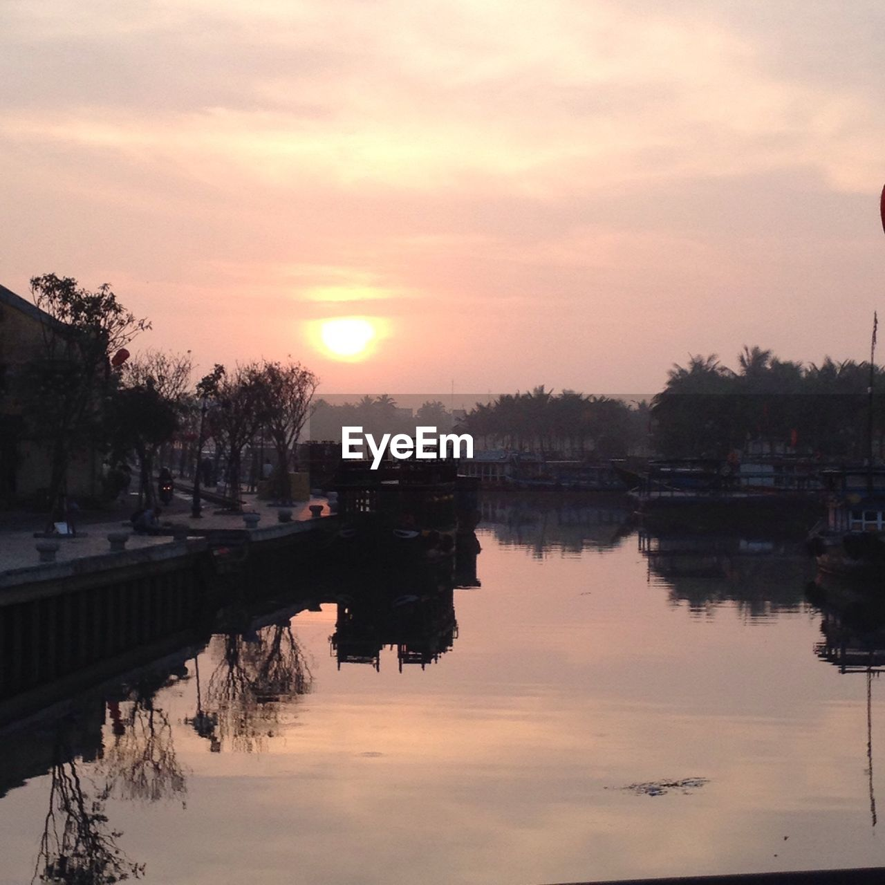 Scenic View Of River During Sunset In Town