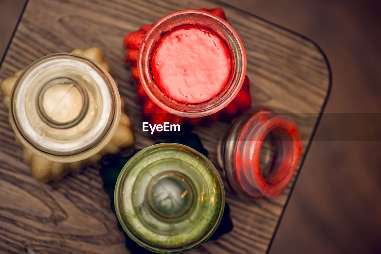 High angle view of colorful jars on table