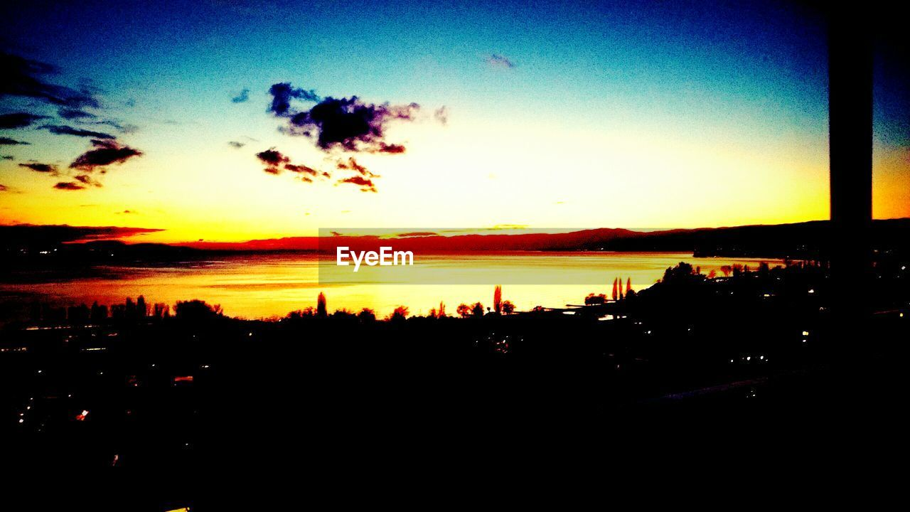 sunset, silhouette, sky, nature, beauty in nature, scenics, no people, tranquility, sea, water, outdoors, city, cityscape