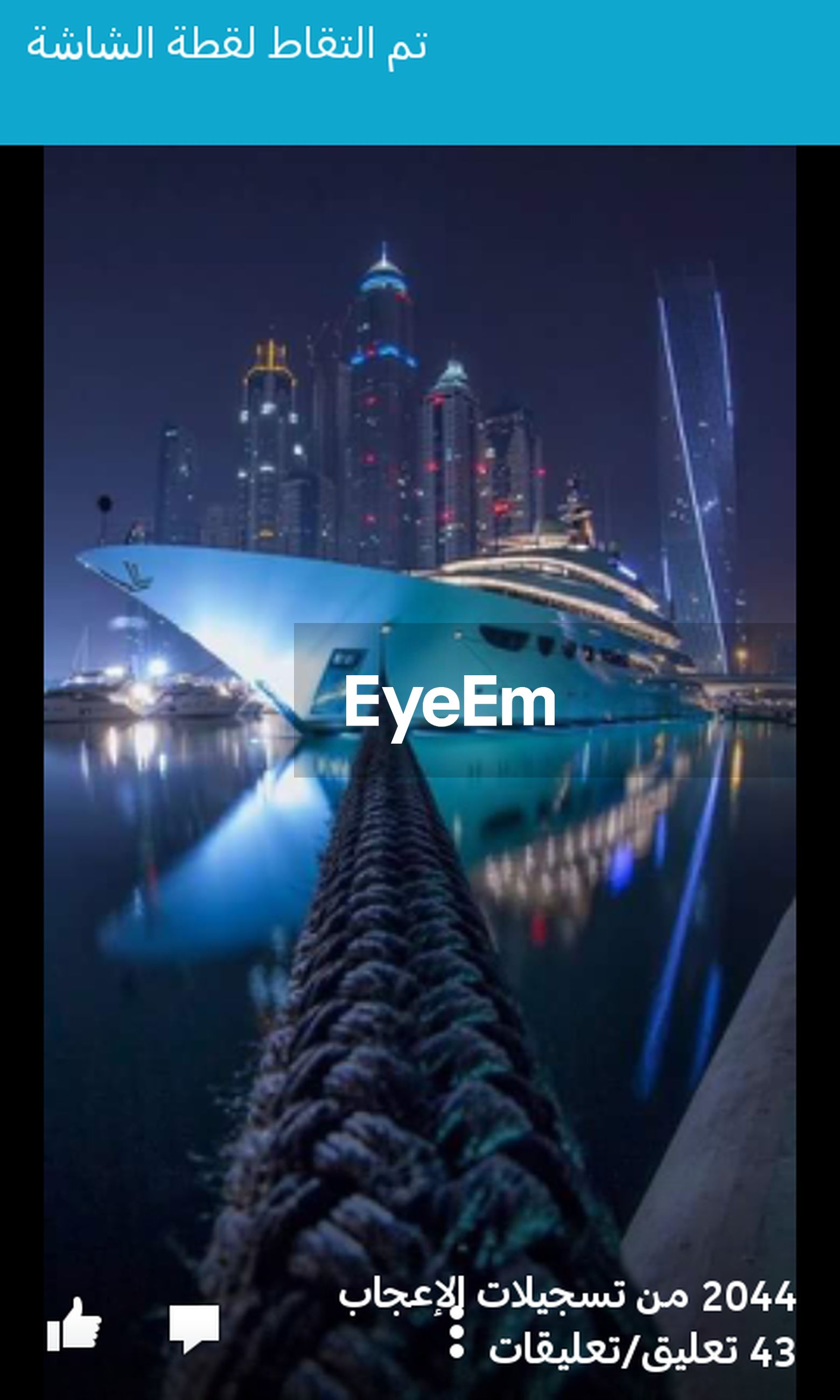 text, illuminated, communication, night, city, western script, architecture, building exterior, built structure, reflection, skyscraper, modern, international landmark, low angle view, famous place, blue, travel destinations, sky, capital cities, no people
