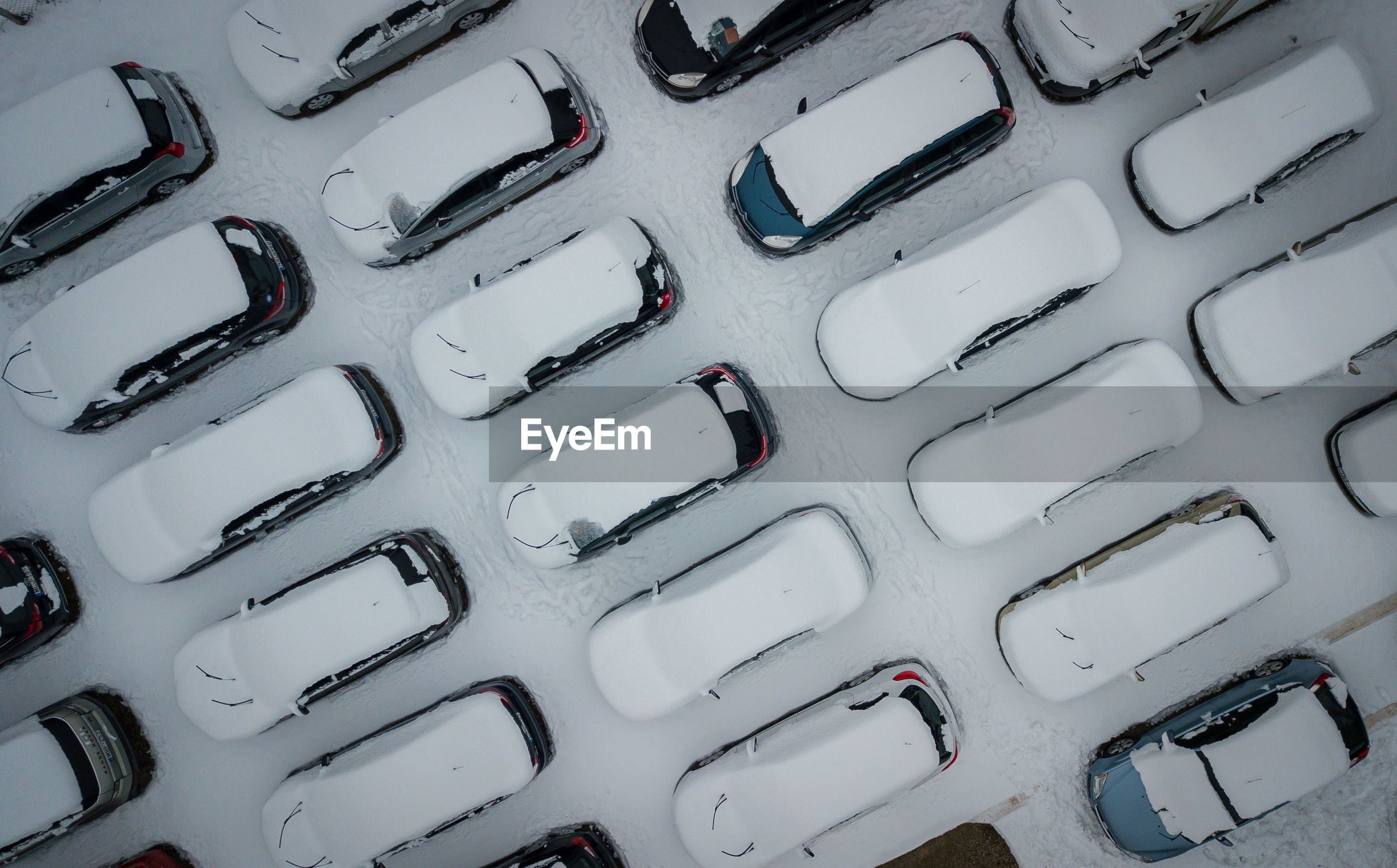 Directly above shot of snow covered cars at parking lot