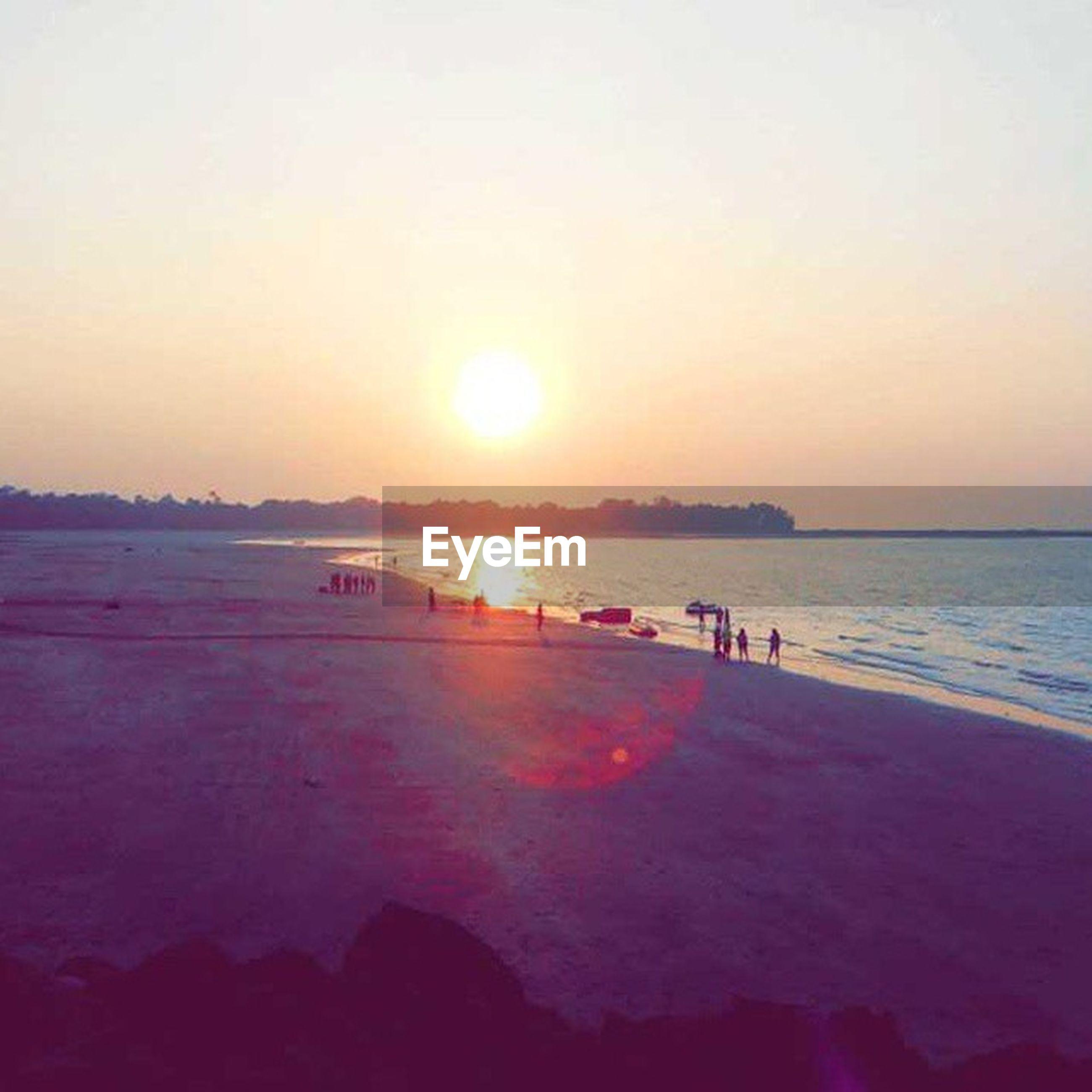 sunset, sun, water, sea, scenics, tranquil scene, beauty in nature, beach, orange color, tranquility, sunlight, nature, idyllic, silhouette, reflection, clear sky, shore, sky, sunbeam, horizon over water