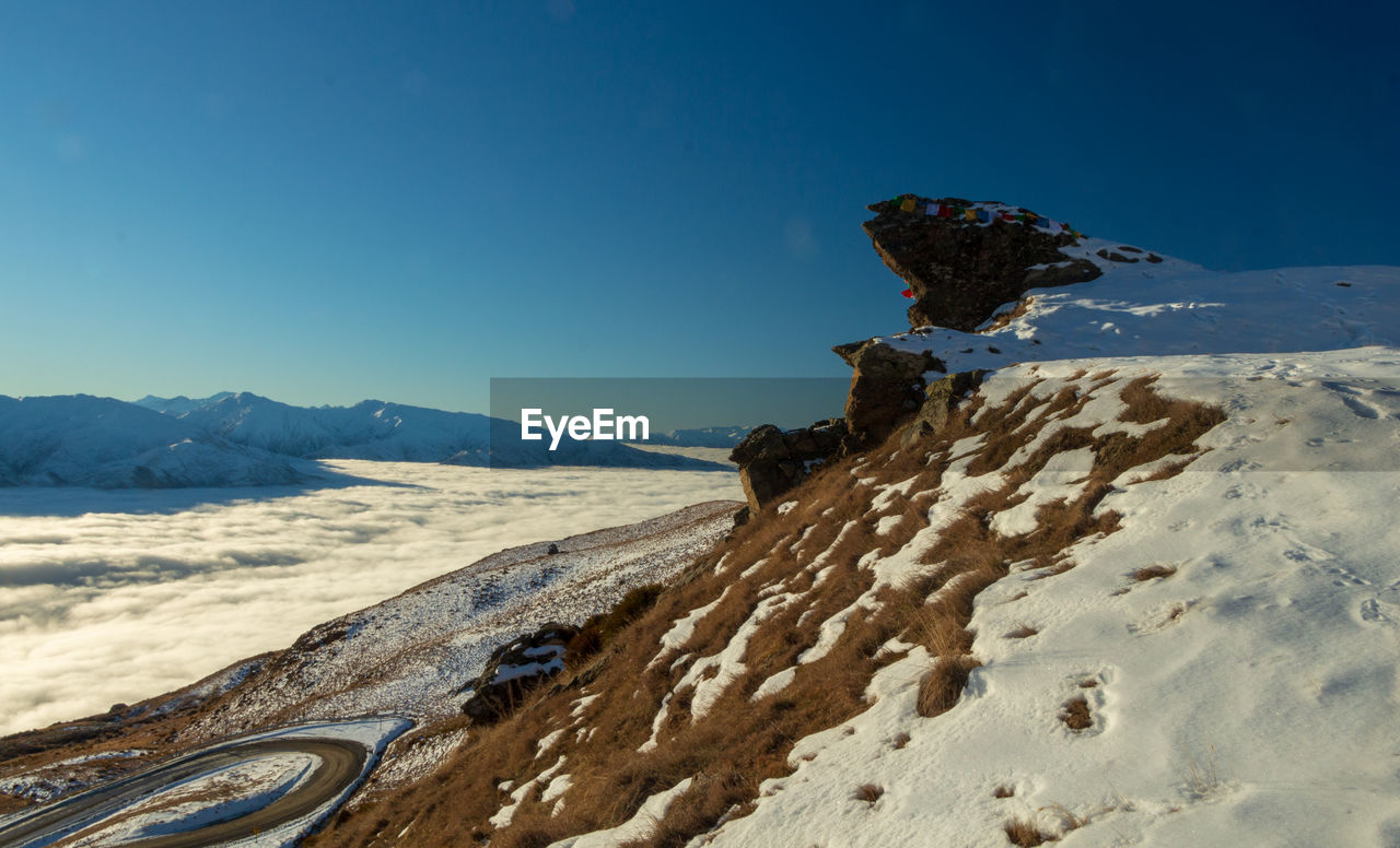 mountain, sky, beauty in nature, scenics - nature, tranquility, nature, tranquil scene, blue, no people, non-urban scene, day, mountain range, idyllic, land, clear sky, landscape, environment, water, winter, remote, snowcapped mountain, mountain peak, arid climate