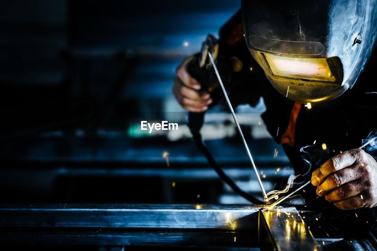 Welder Welding Metal In Factory