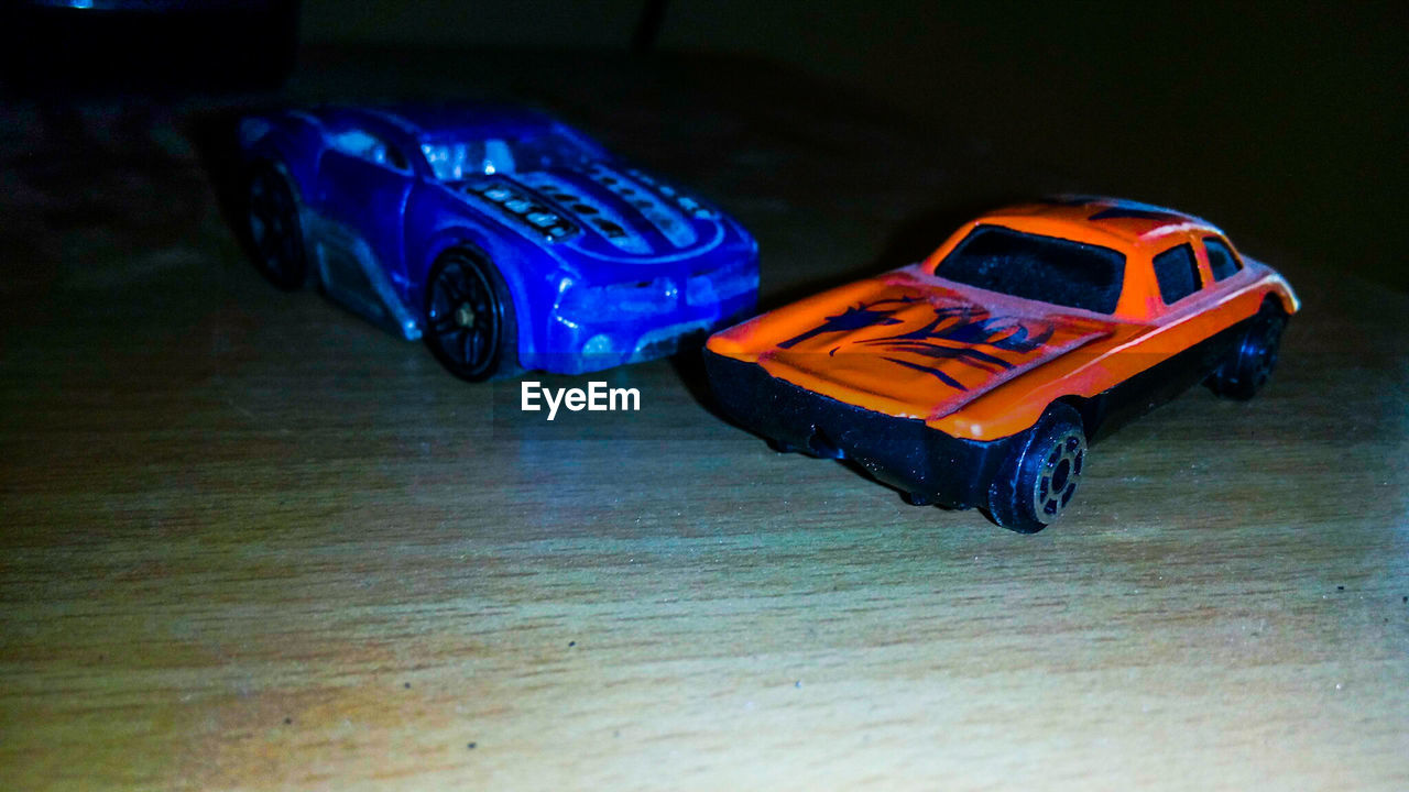 toy car, toy, car, land vehicle, transportation, no people, indoors, childhood, close-up, day