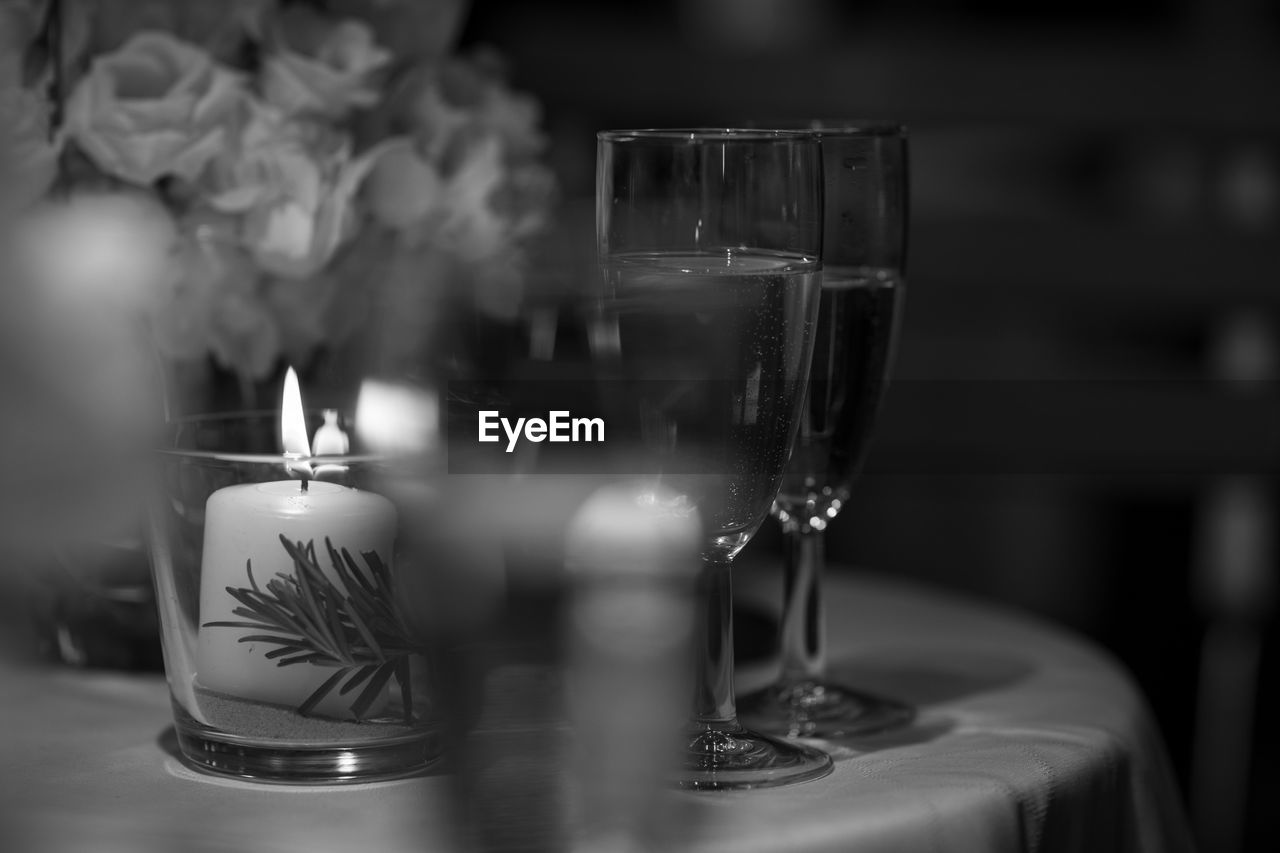 glass, candle, table, drink, refreshment, wineglass, food and drink, transparent, fire, burning, drinking glass, indoors, household equipment, close-up, wine, flame, no people, selective focus, glass - material, alcohol, tea light, setting