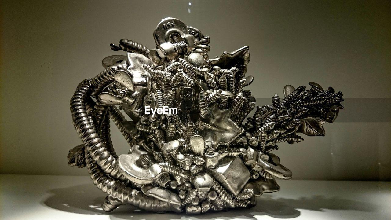 art and craft, statue, sculpture, human representation, no people, close-up, indoors, studio shot, crown, day