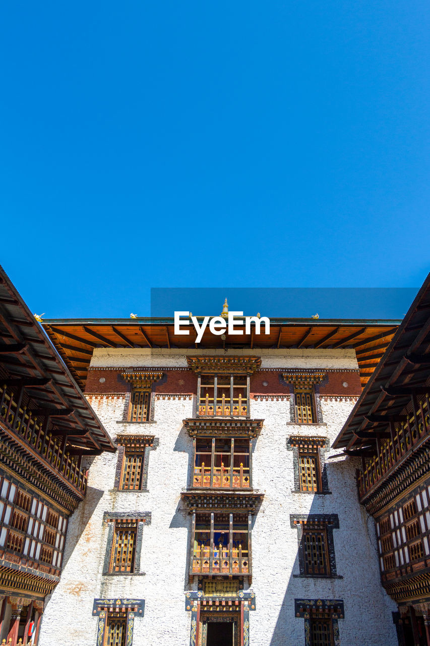 architecture, built structure, building exterior, sky, clear sky, building, roof, blue, copy space, low angle view, day, no people, nature, place of worship, religion, belief, travel destinations, spirituality, sunlight, outdoors, roof tile, ornate