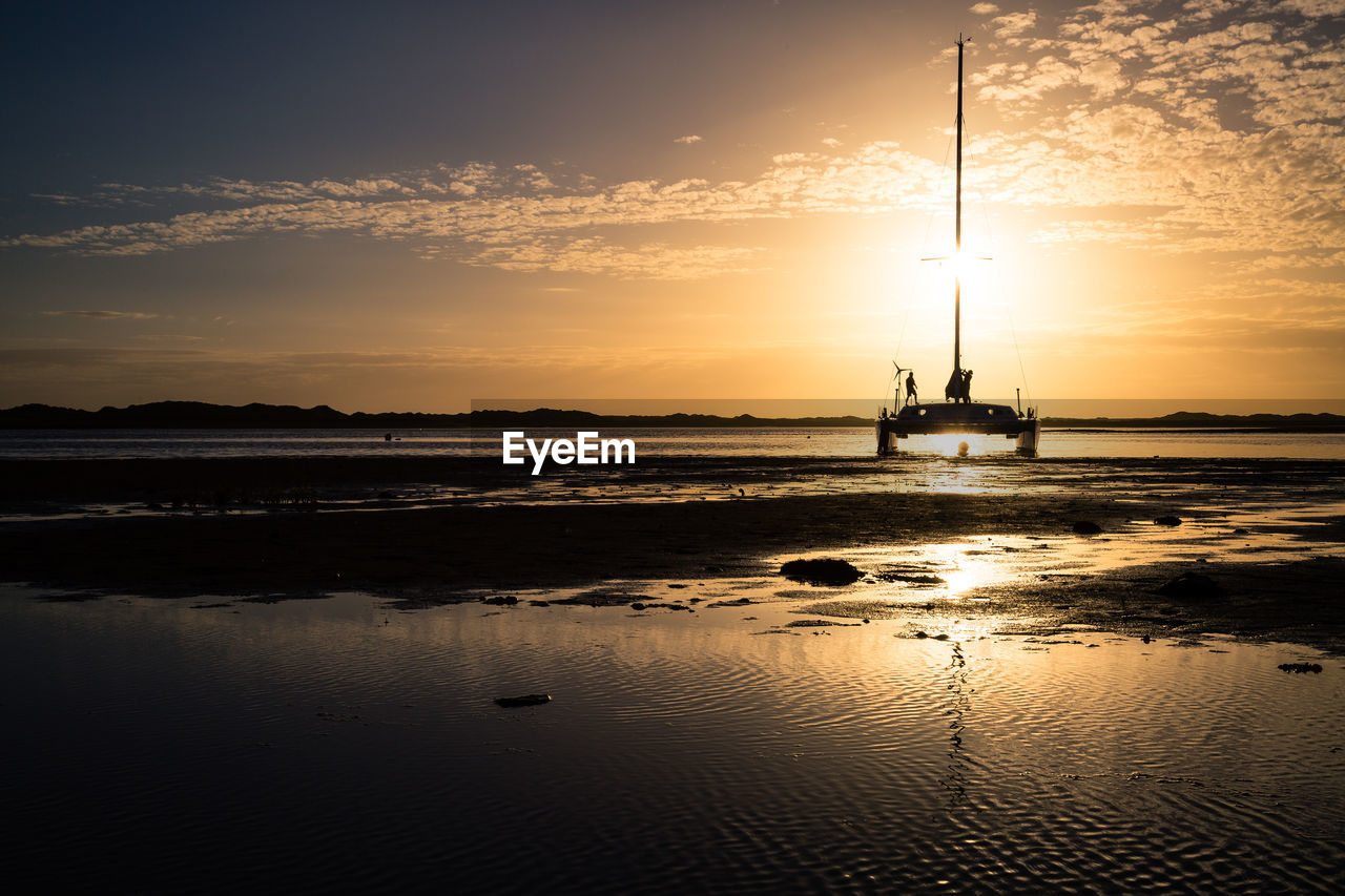 Silhouette Of Yacht Moored On Shore Of Ravenglass Estuary