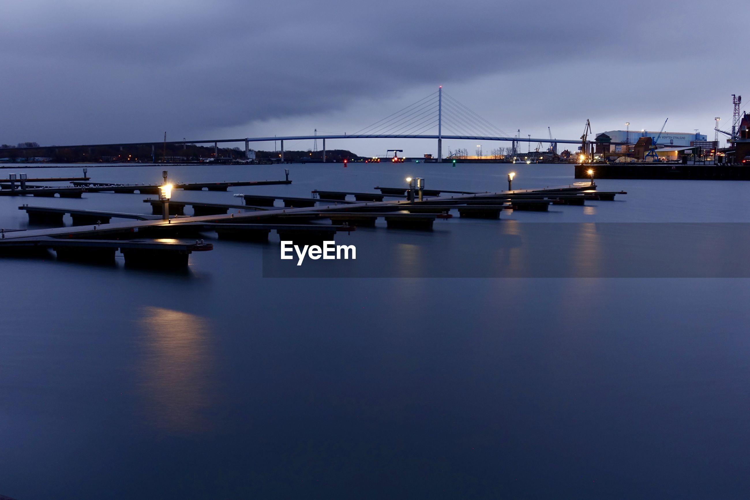 SUSPENSION BRIDGE OVER SEA AGAINST SKY