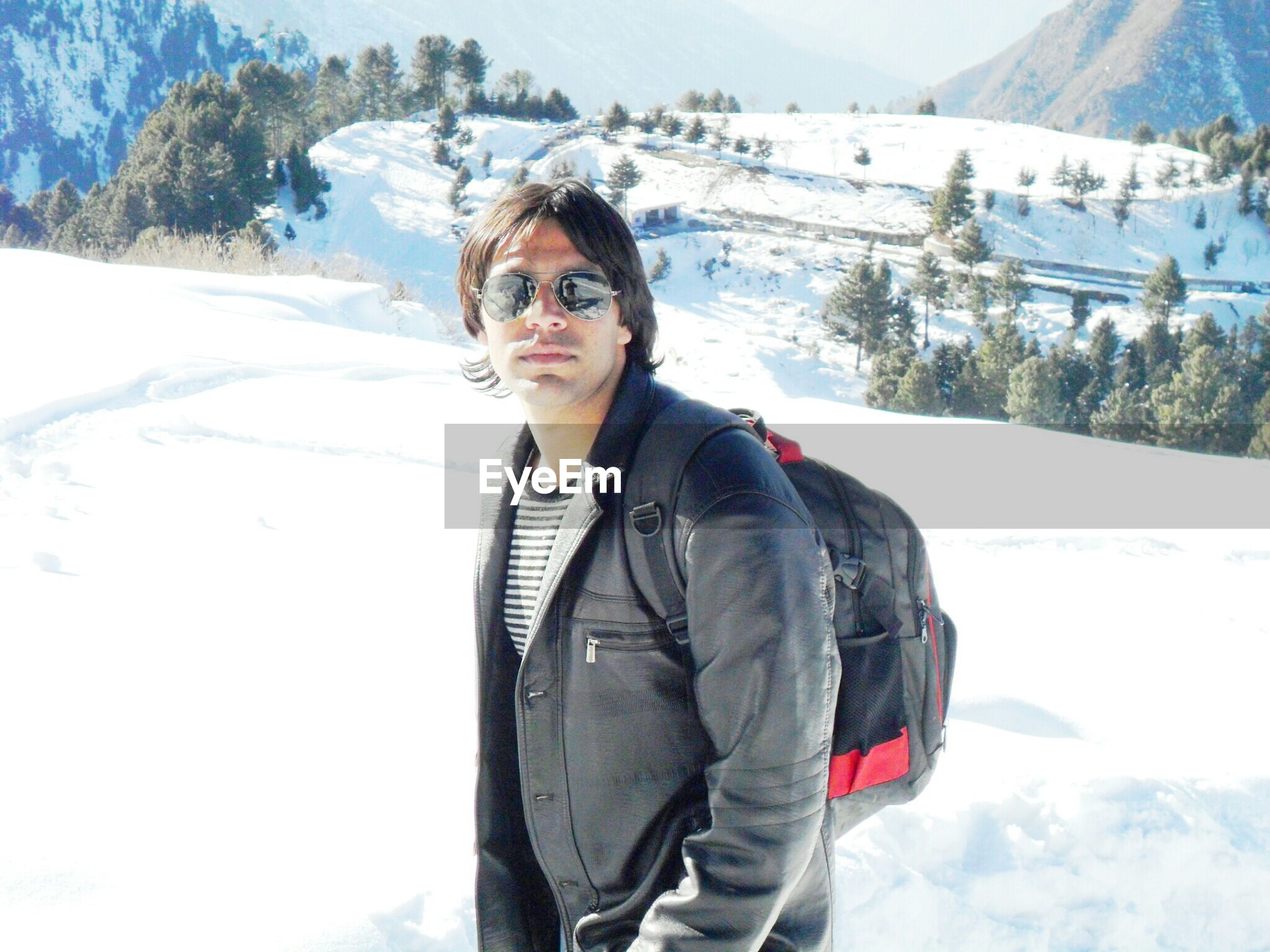 snow, winter, cold temperature, season, weather, warm clothing, lifestyles, mountain, leisure activity, covering, snowcapped mountain, frozen, young adult, white color, portrait, standing, looking at camera, nature