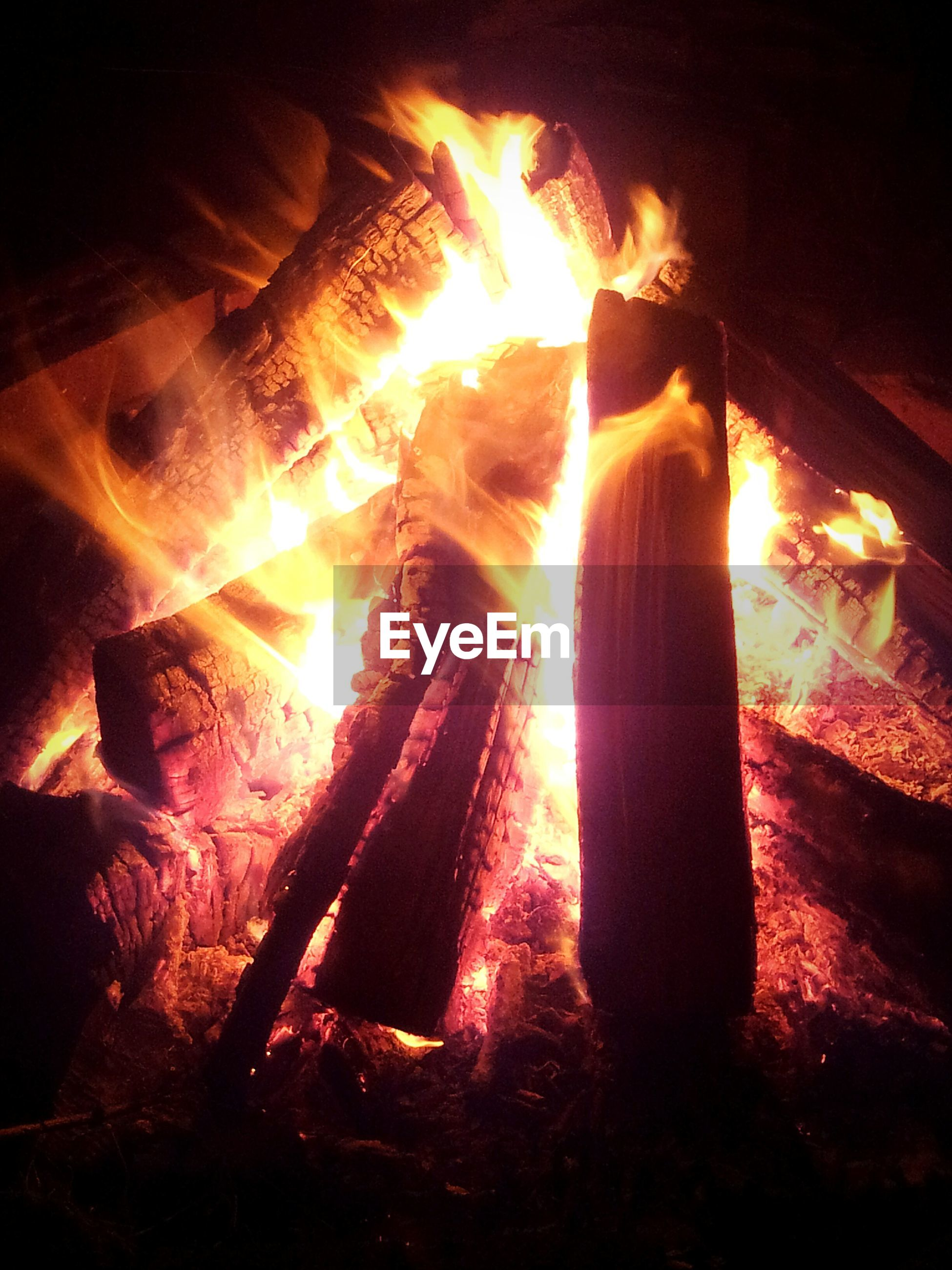 burning, flame, fire - natural phenomenon, heat - temperature, glowing, night, indoors, illuminated, bonfire, fire, candle, firewood, close-up, heat, campfire, light - natural phenomenon, lit, dark, wood - material, fireplace