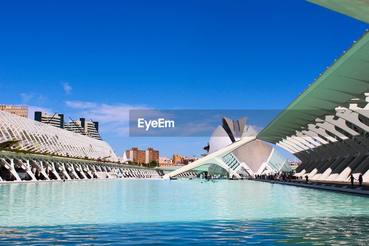 architecture, water, sky, built structure, blue, building exterior, nature, waterfront, bridge, travel destinations, day, connection, no people, tourism, bridge - man made structure, transportation, city, travel, building, outdoors, modern, swimming pool