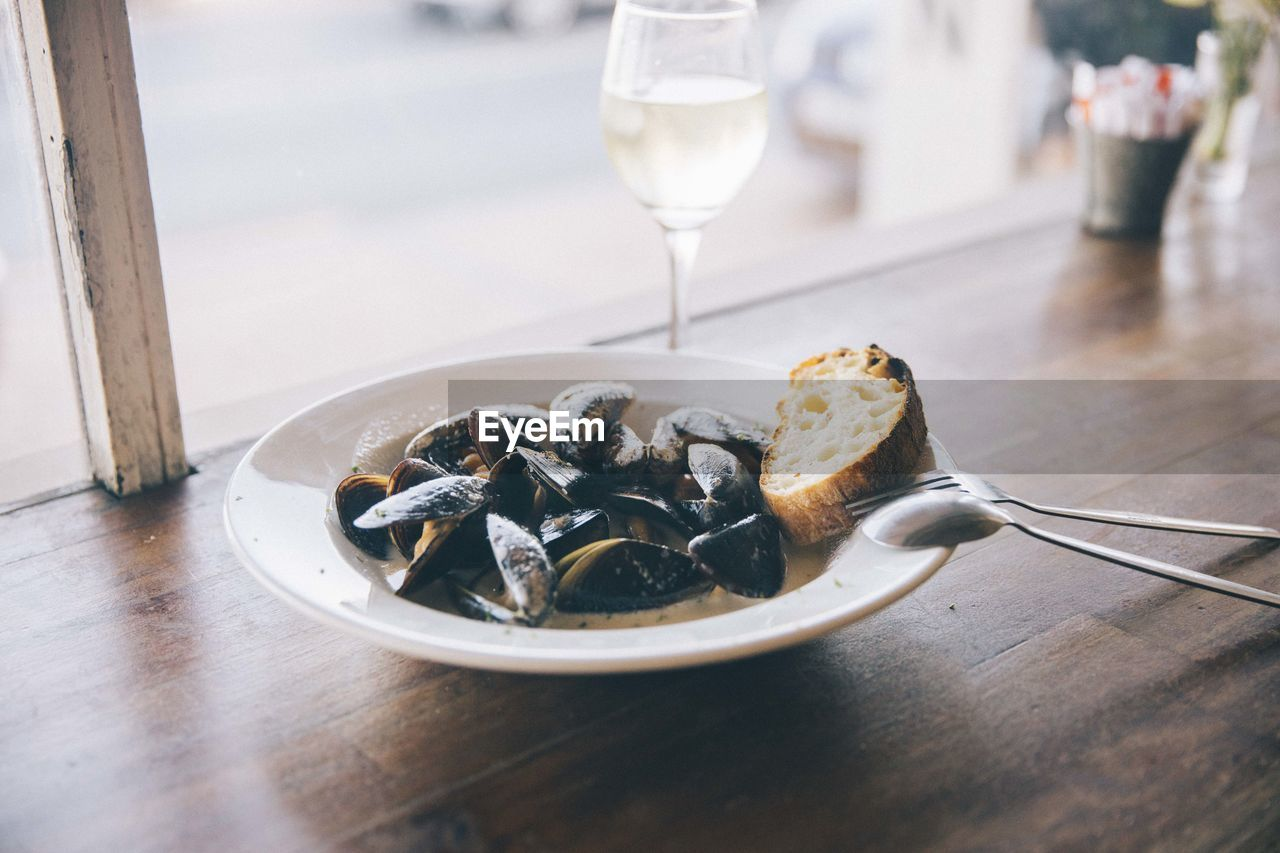 food and drink, table, food, kitchen utensil, freshness, ready-to-eat, glass, refreshment, eating utensil, mussel, drink, indoors, close-up, healthy eating, serving size, no people, wine, spoon, seafood, wellbeing, temptation
